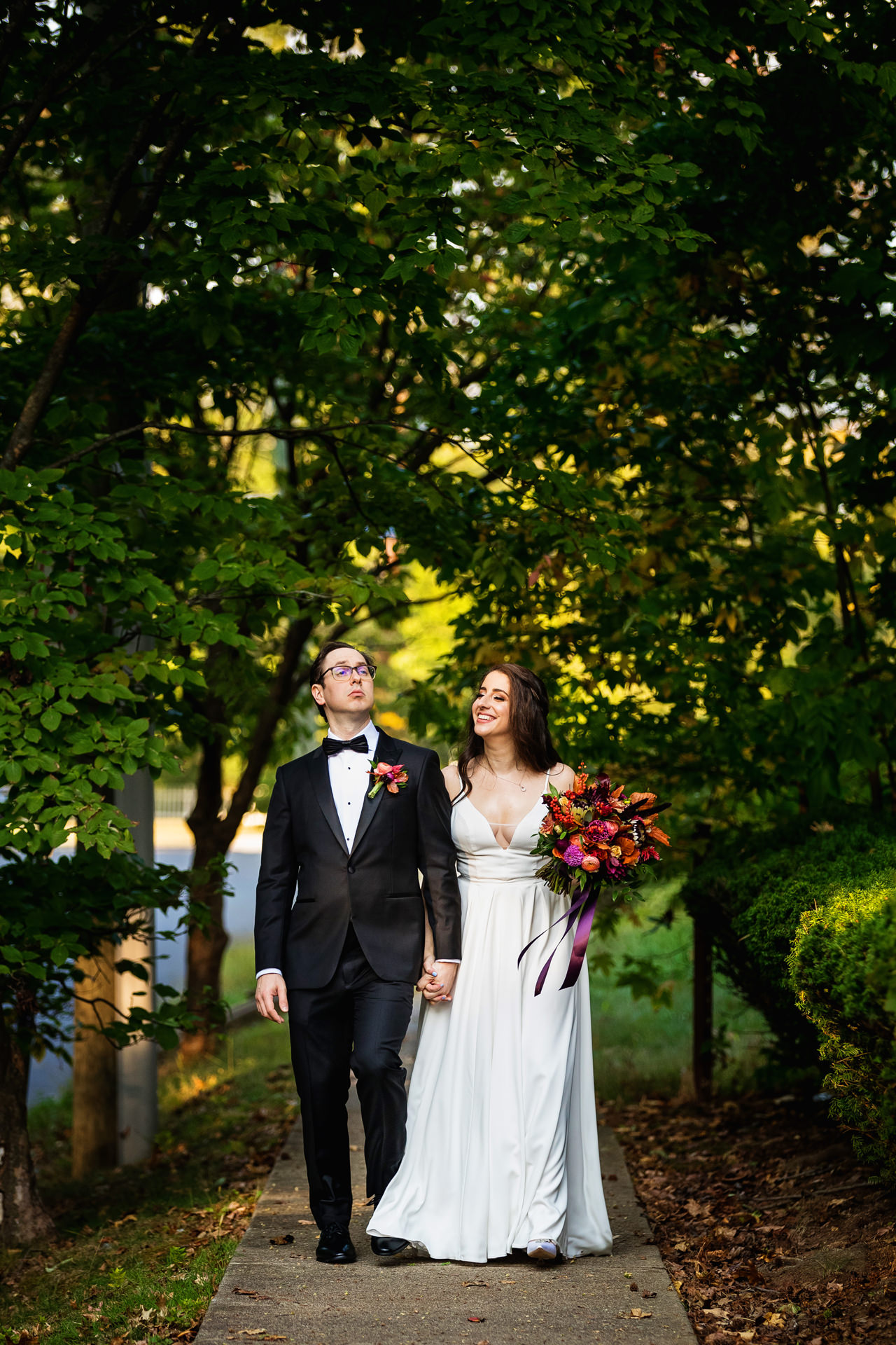 New Jersey Private Wedding Photos | The newlyweds walk down the sidewalk