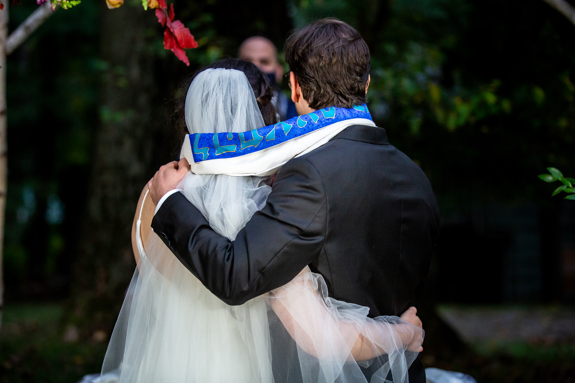 Montclair New Jersey Backyard Wedding Ceremony Pic | The bride and groom with arms around one another