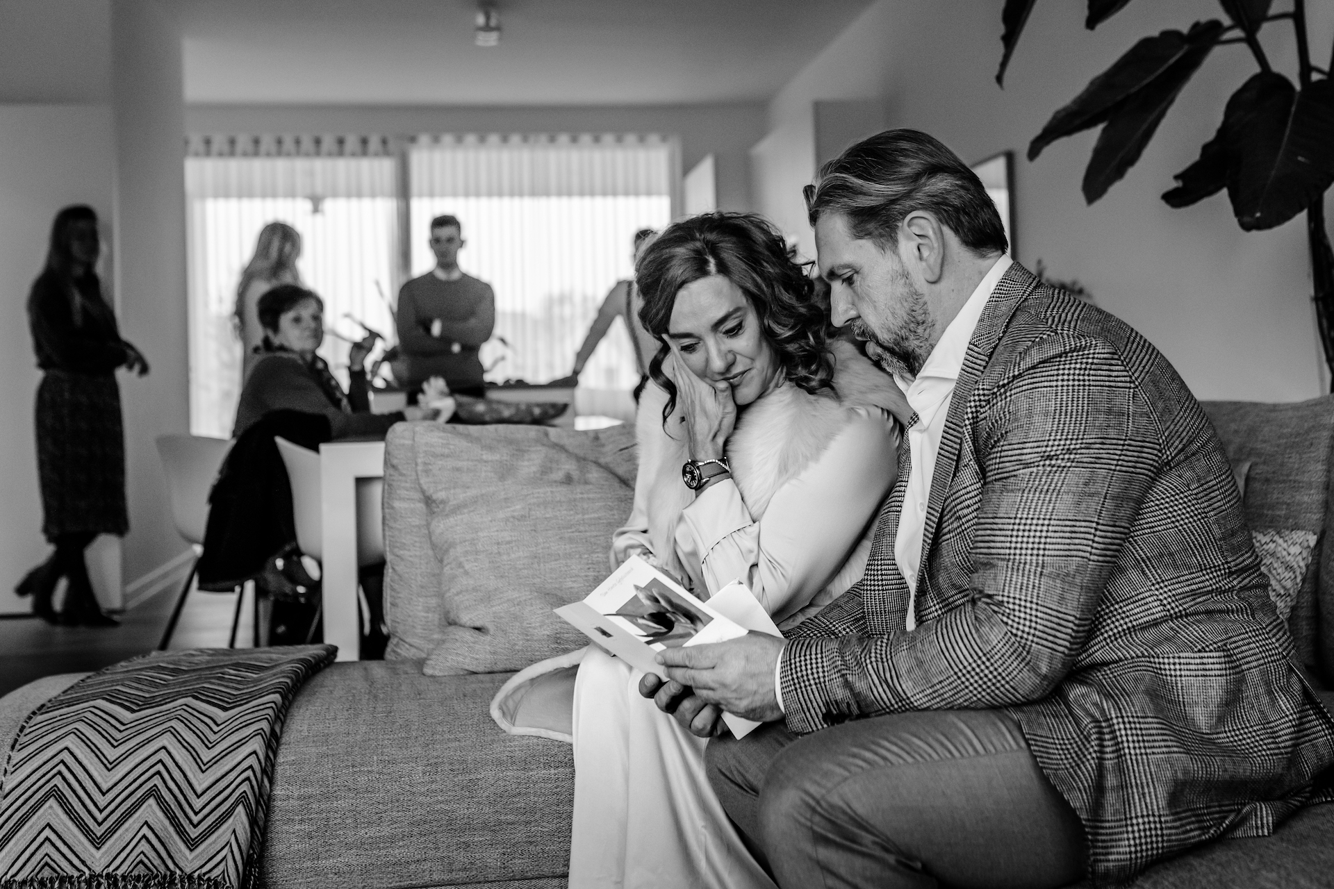Wedding Photo from a Belgium Home | The bride and groom take a moment to read a card t