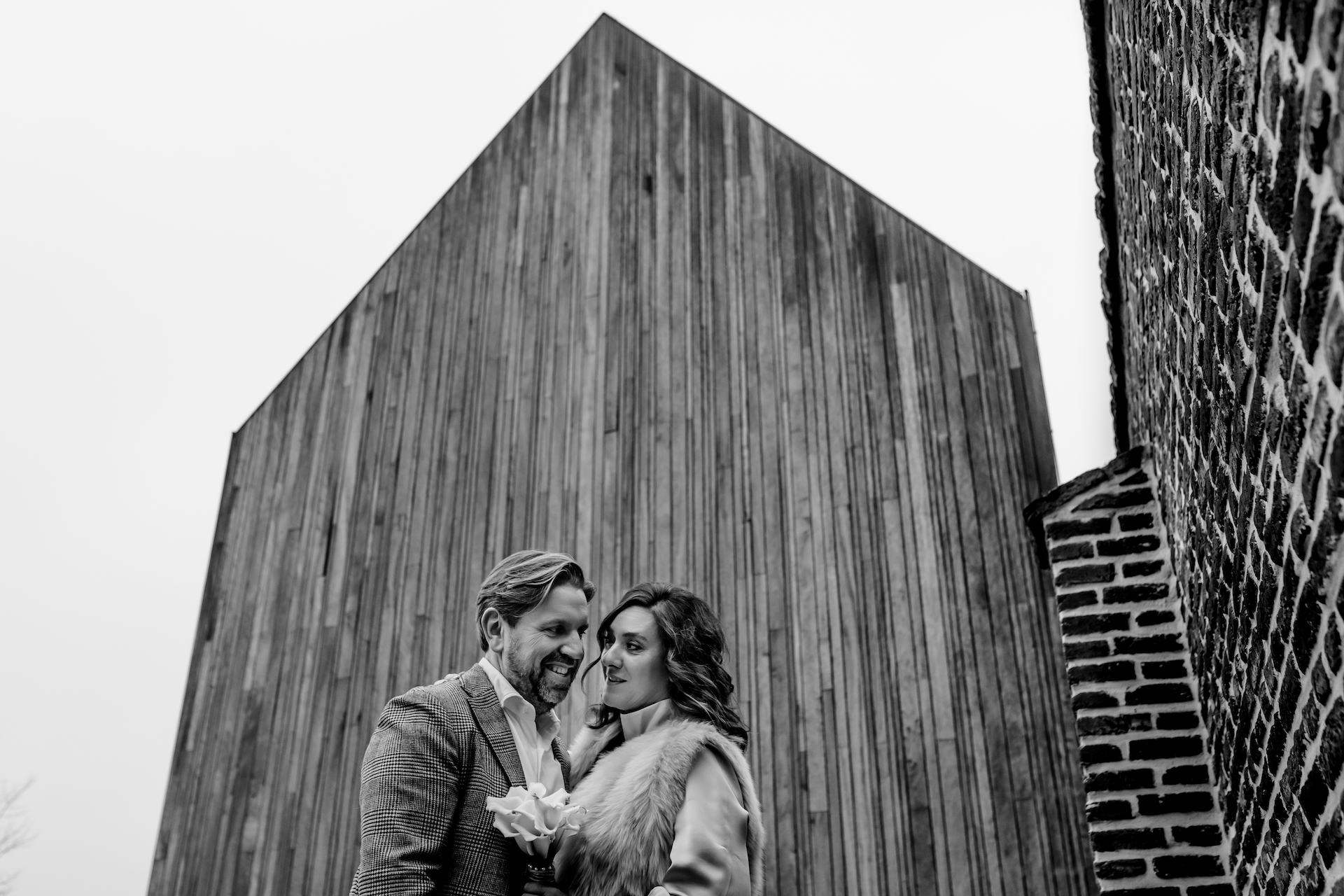 Herkenrode, Belgium Wedding Couple Portrait Session | The newlyweds pose for a striking photo