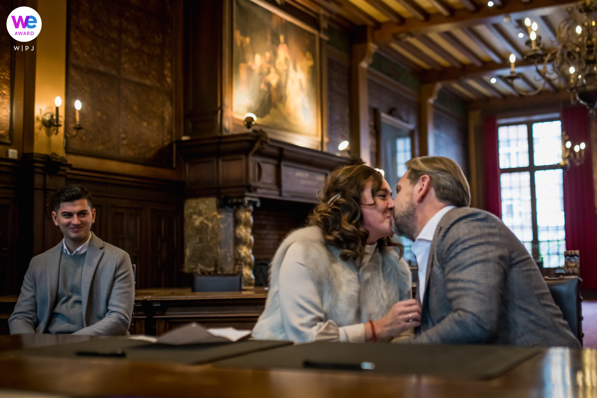 Photography from a Belgium Town Hall Wedding as The bride and groom share a sweet kiss at the end of their civil ceremony