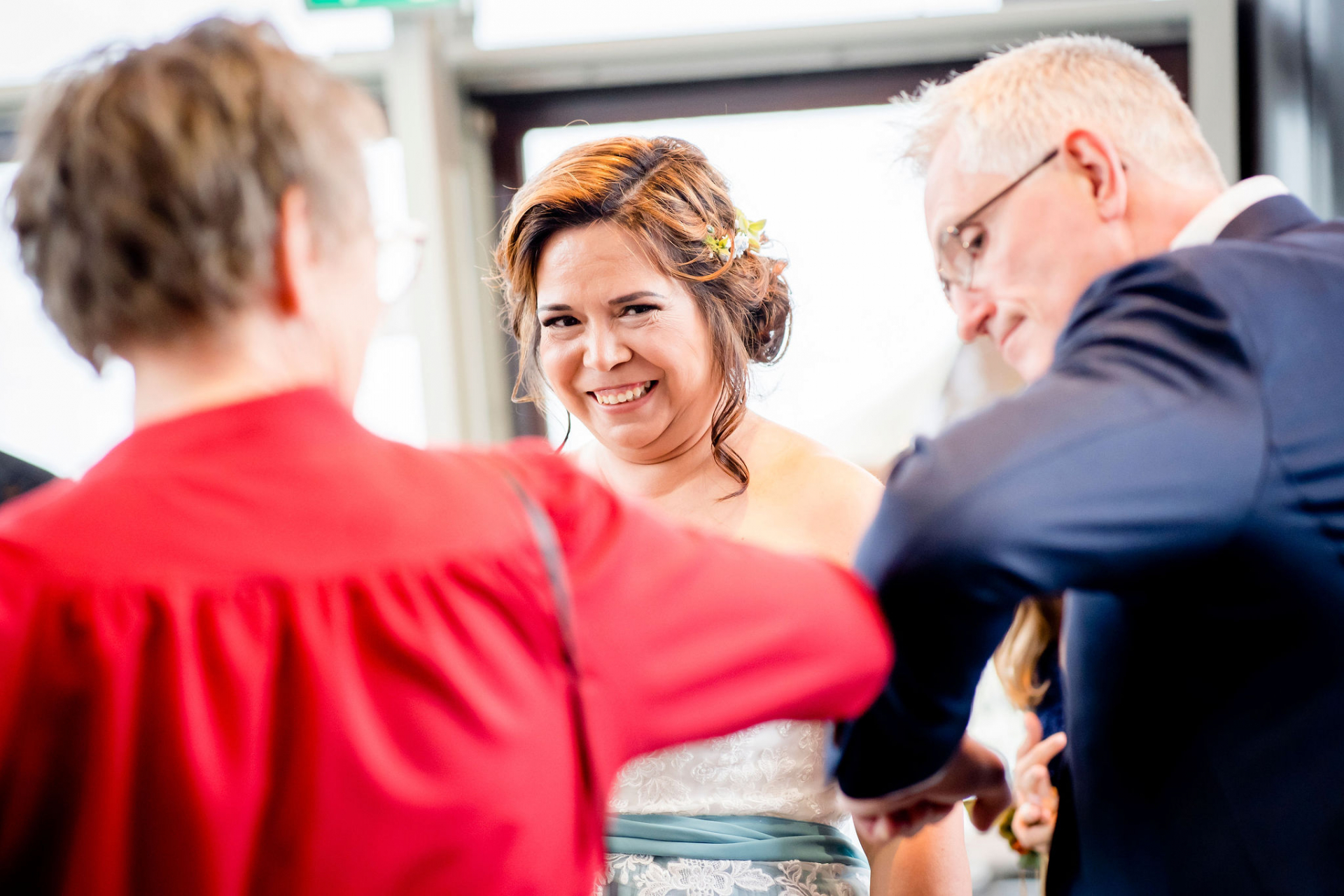 Top Wedding Photography of Netherlands | The bride laughs as the groom shares a COVID-friendly elbow bump