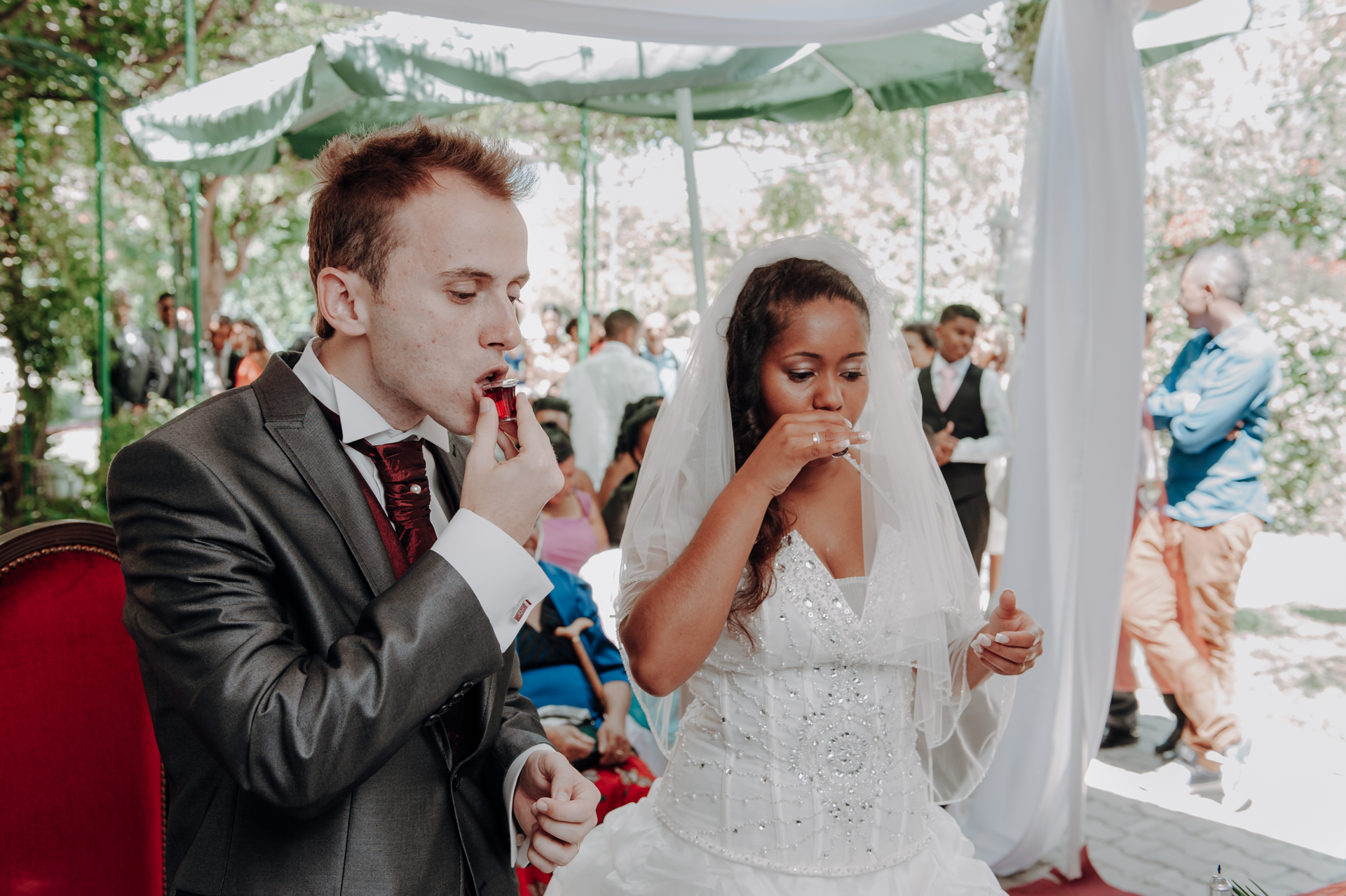 Professional Photographers in Lisbon | The bride and groom sip a red beverage that symbolizes the Blood of Christ