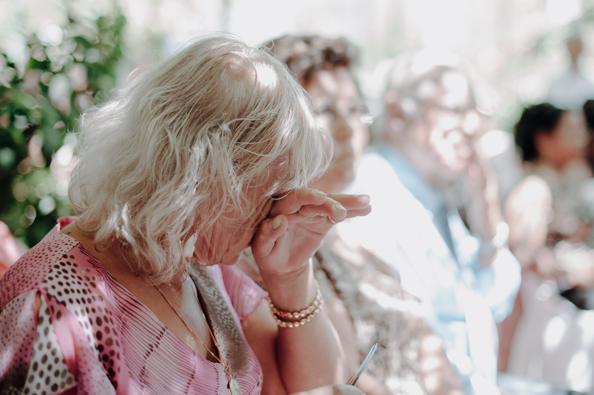 Wedding Photographers of Lisbon, Portugal | Overcome with emotion, the groom's mother wipes away a tear