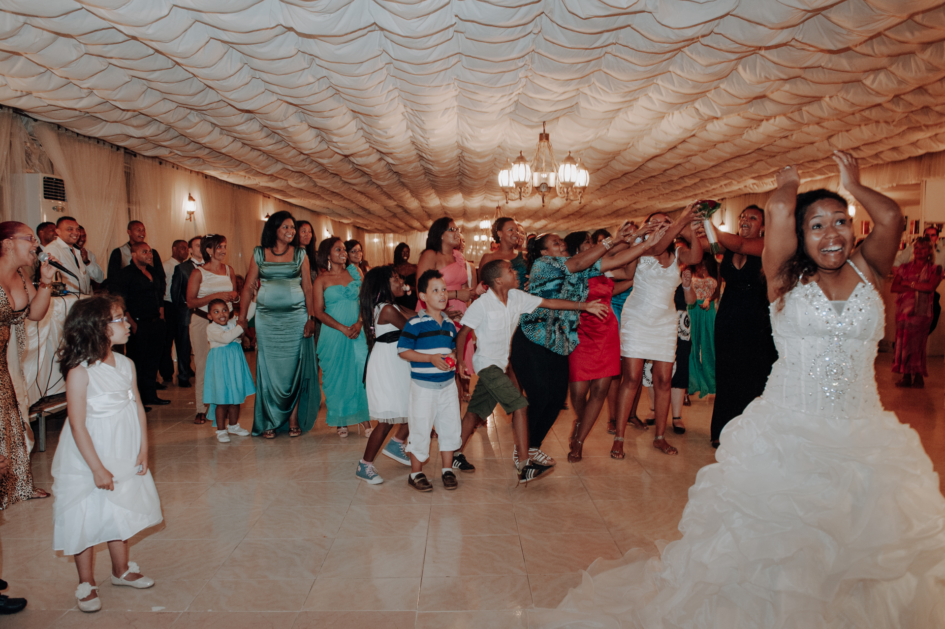 Portugal Wedding Reception Image, Lisbon | The bride tosses her bouquet toward hopeful guests