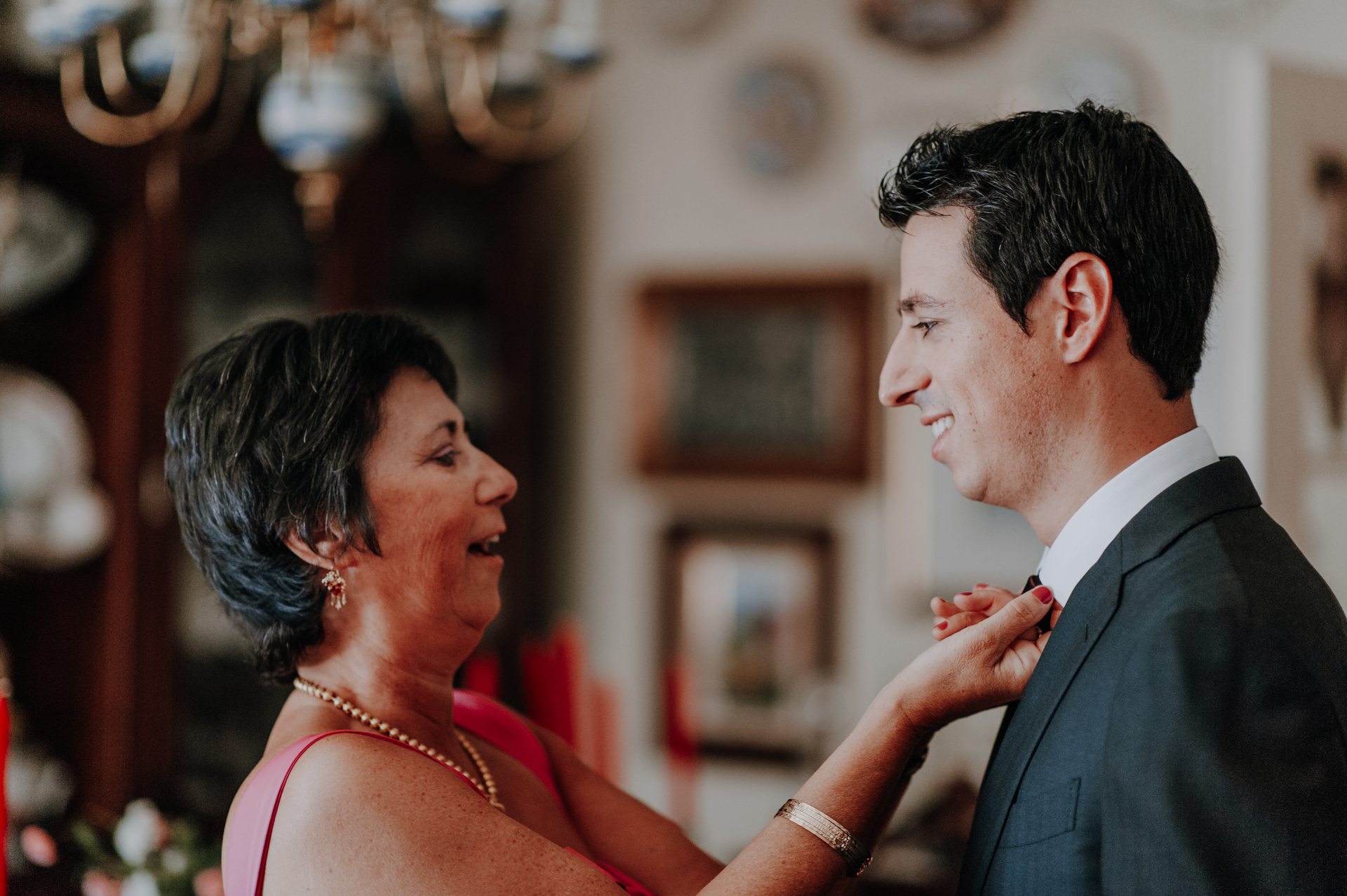 Lisbon Wedding Event Picture | The groom's mother adjusts his tie