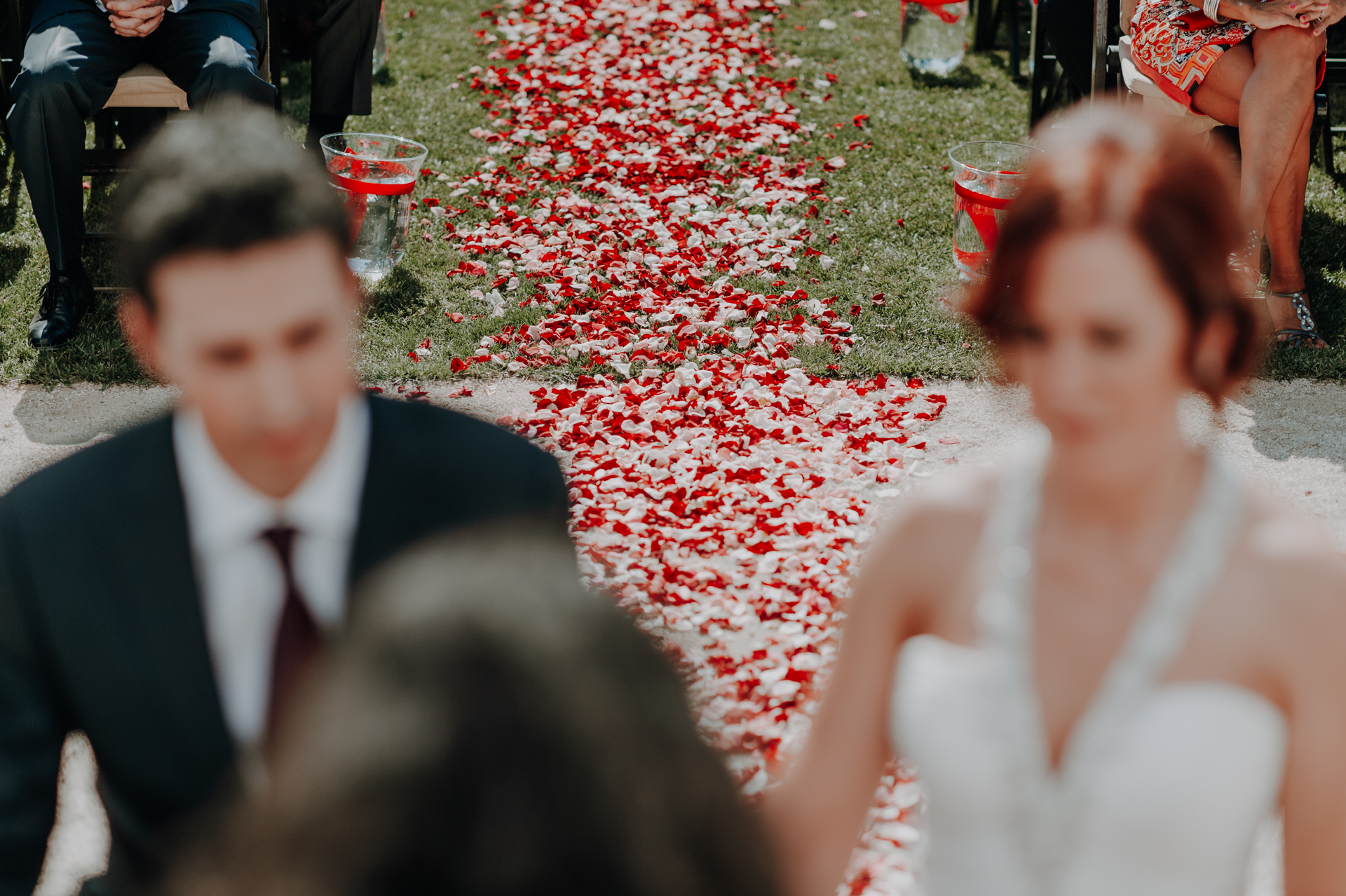 Quinta do Valle do Riacho Wedding Event Photographer | The vibrant aisle made solely of red and white rose petals