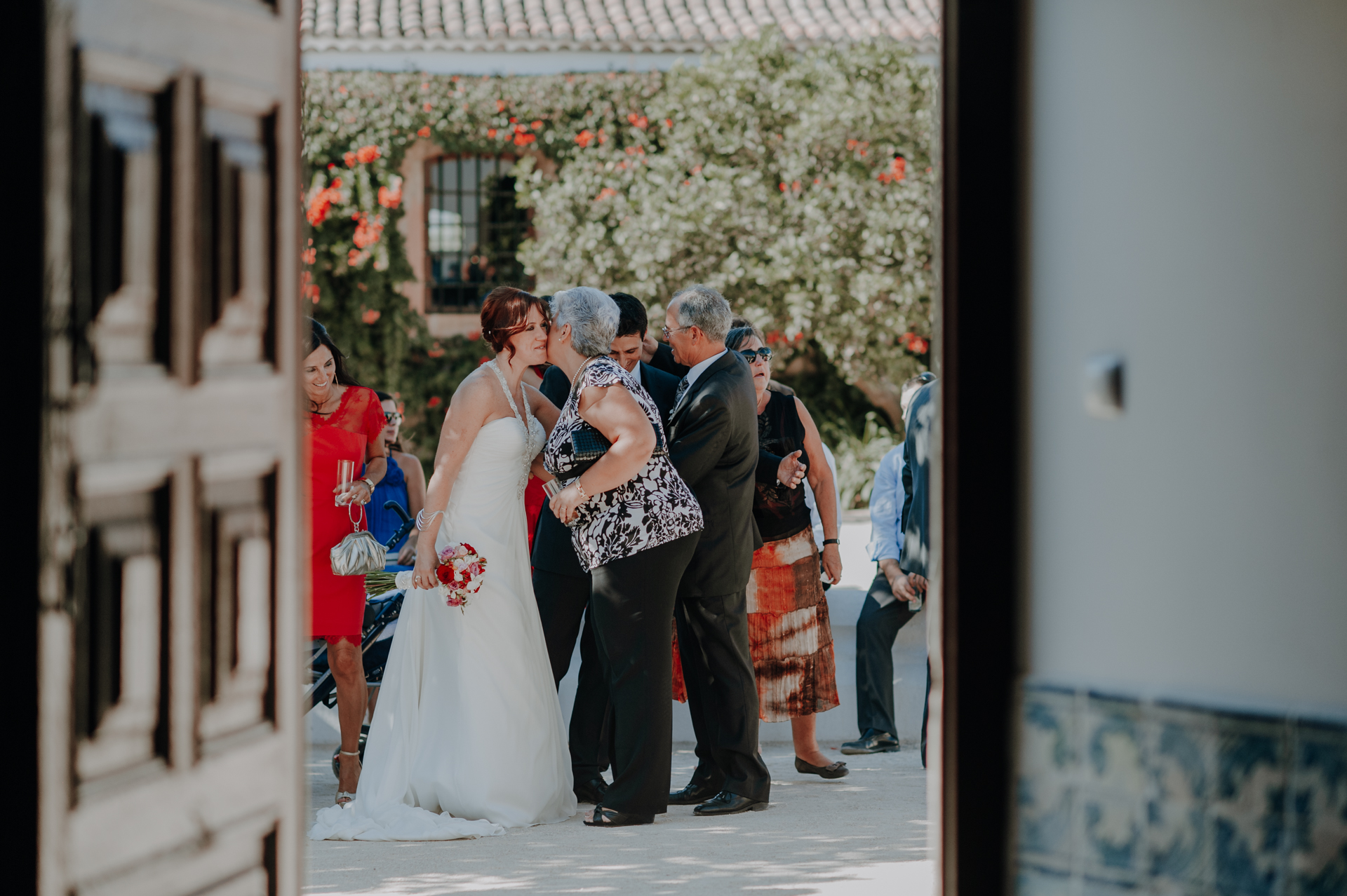 Wedding Ceremony Venue Quinta do Valle do Riacho Pic | The bride greets a wedding guest with a kiss