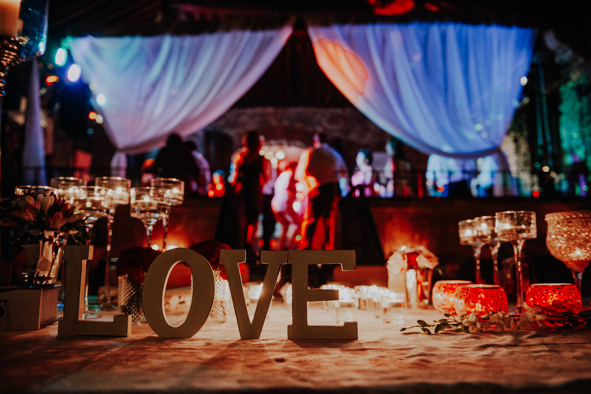 Destination Wedding Photography - Alenquer, Portugal | Basking in the glow of colorful lights and with romance in the air