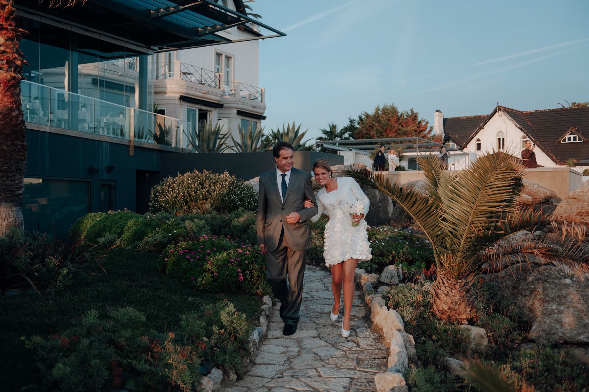 Destination Wedding Venue Picture - Cascais, Portugal | Walking with her father down the cobblestone path that served as her aisle