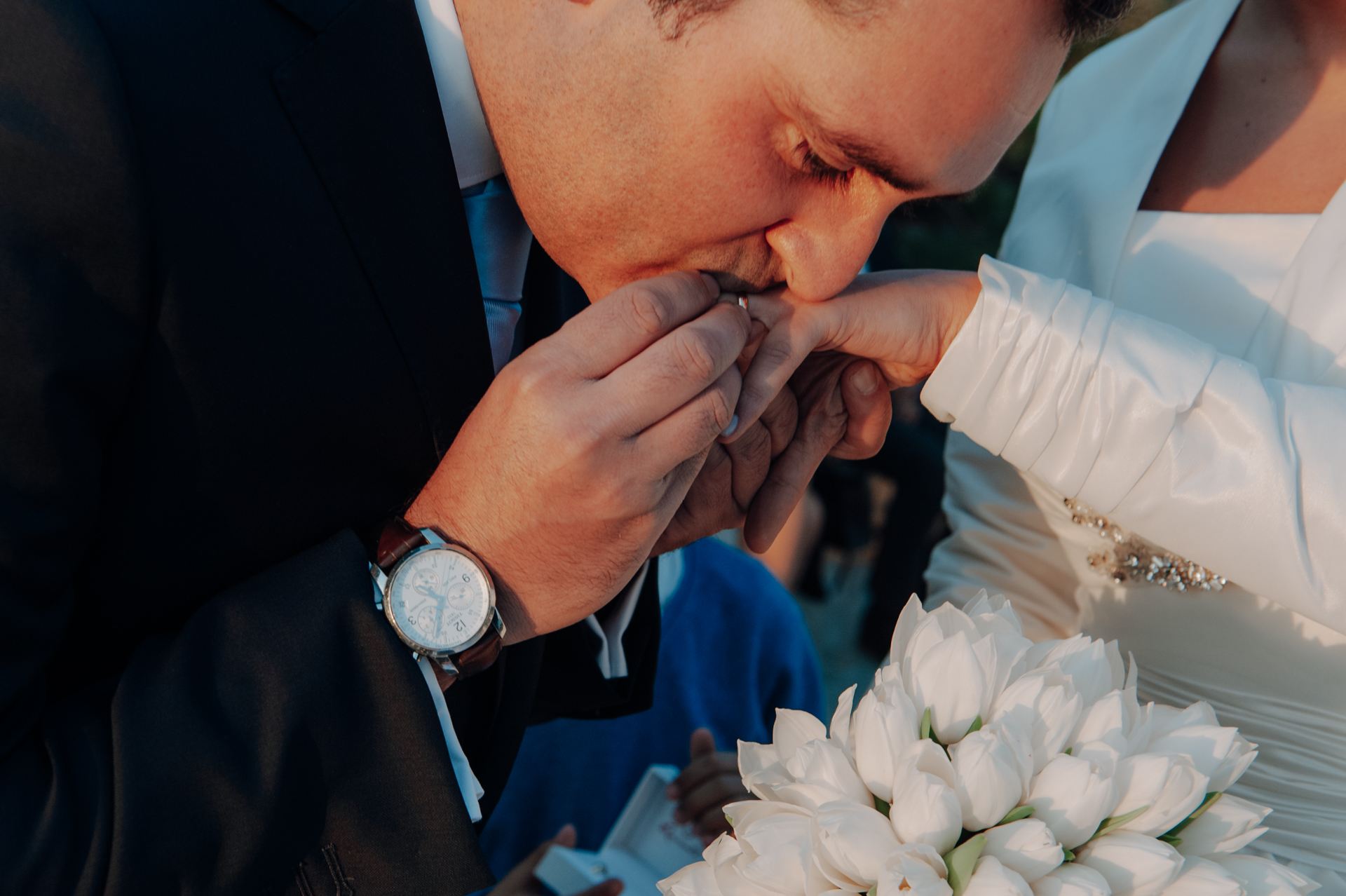 Farol Design Hotel Weddings - Cascais, Portugal Photography | The groom kisses the brides finger immediately