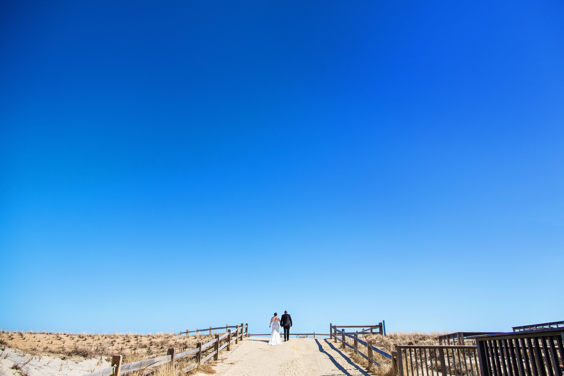 Long Beach Island NJ Wedding Portraits - The Gables | Sandy Shores Image of the couple at Beach Haven, New Jersey