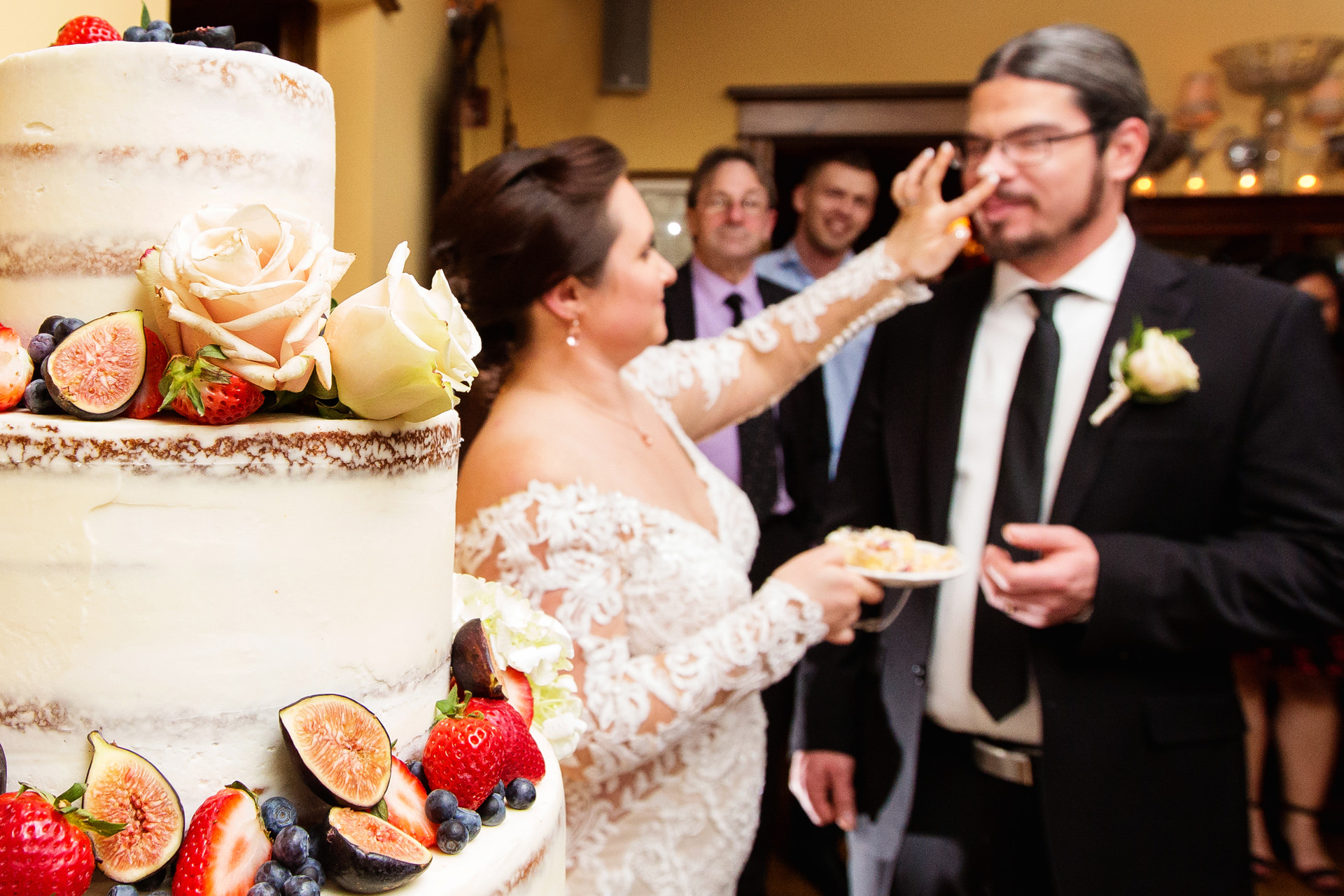 NJ Wedding Venue Photography - The Gables Inn | The bride places some cake on the grooms nose