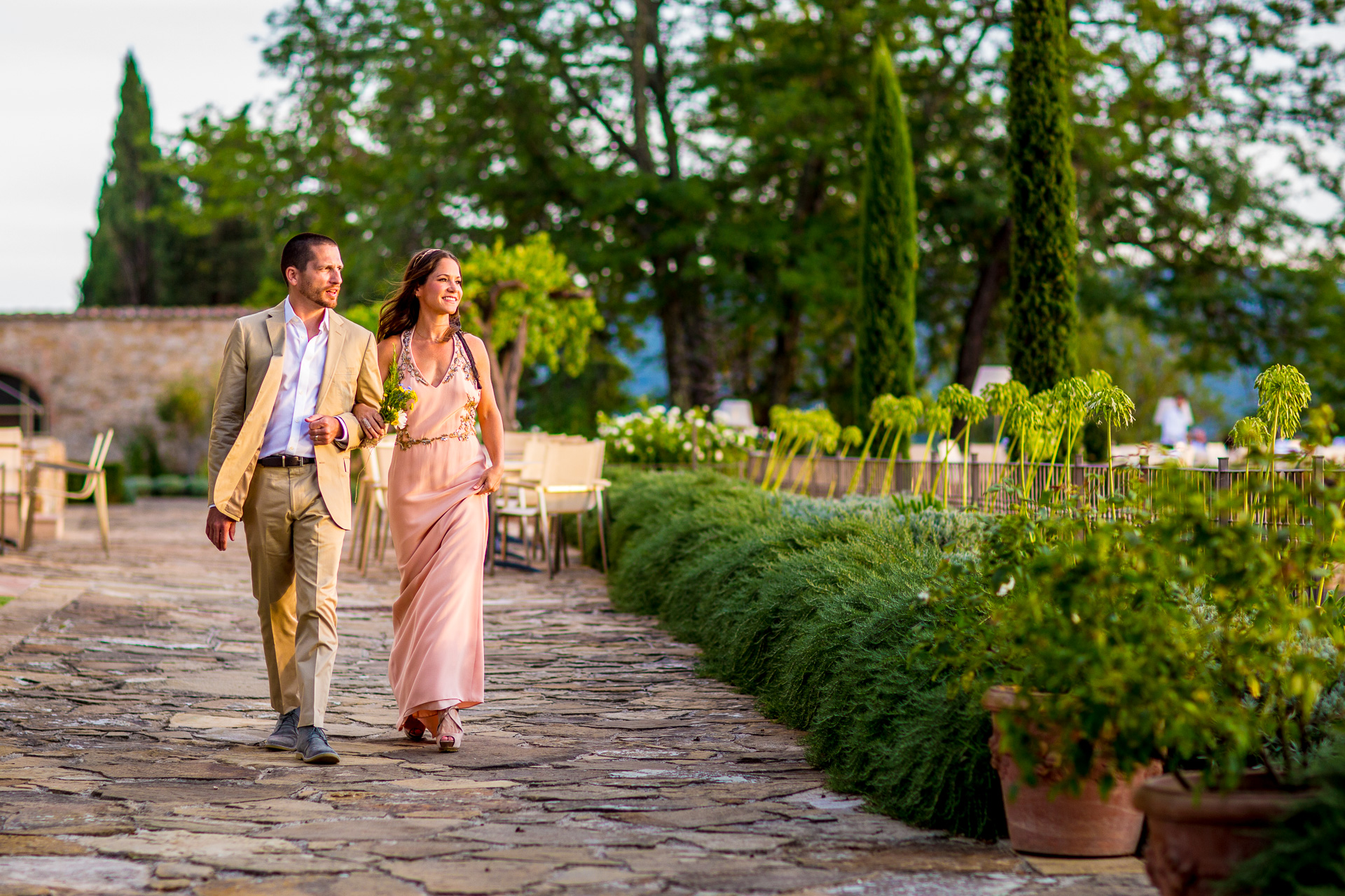 Weddings in the Heart of Tuscany at Casali Di Casole | arms linked and looking utterly relaxed