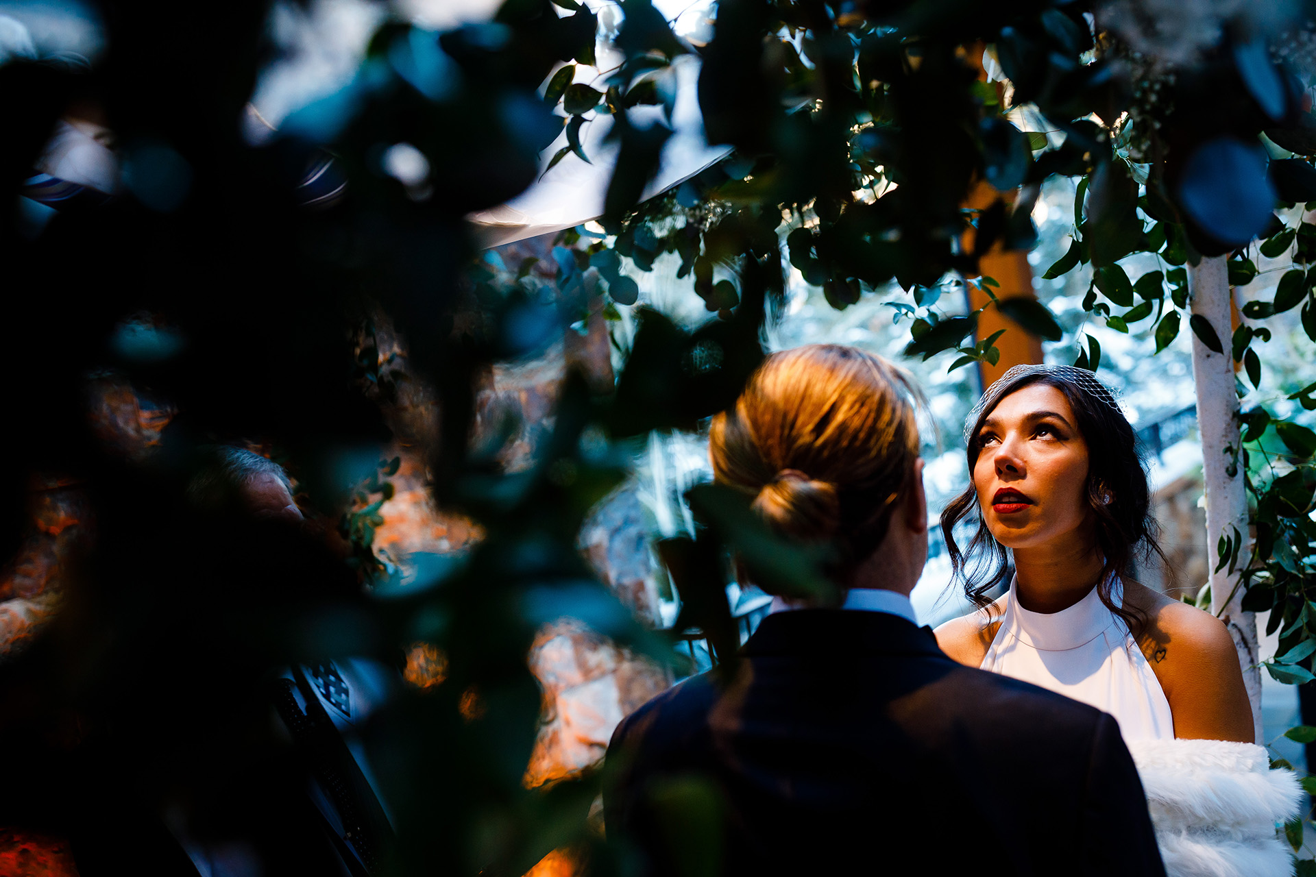 Colorado Mountain Wedding Photographers of Vail | the vines of the pergola make them appear as if they are in an enchanted forest