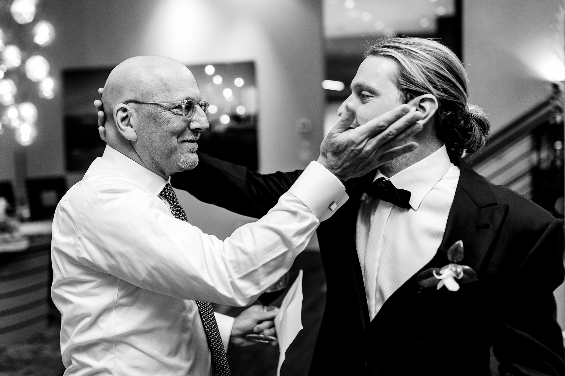 Mountain Wedding Photography for Vail Colorado | The groom and his father share a tender moment together after the ceremony