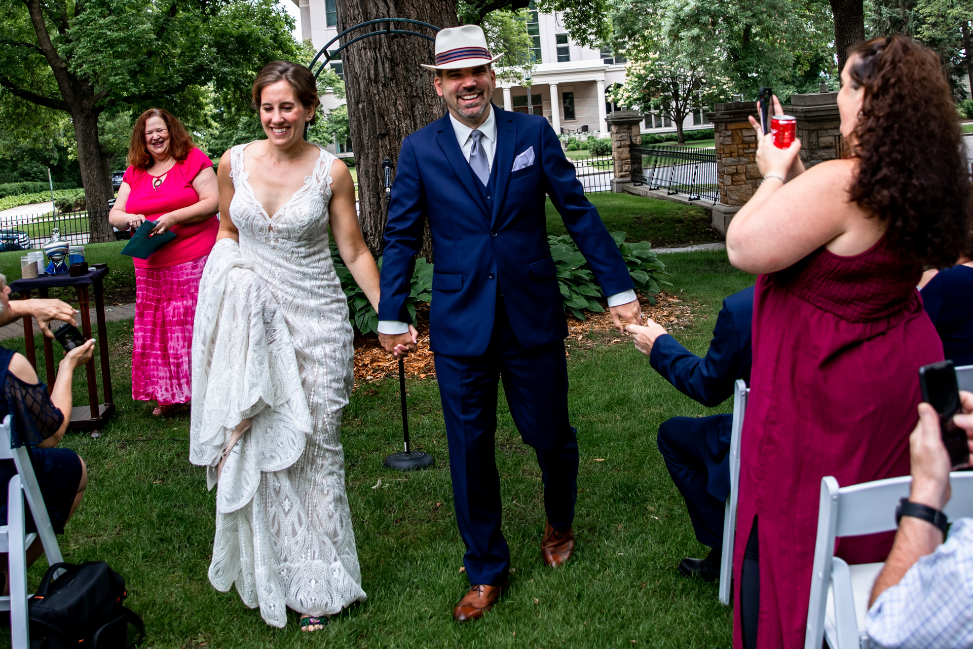 Wedding Photography from St. Paul, MN at Summit Manor | The newlyweds happily walk back down the aisle