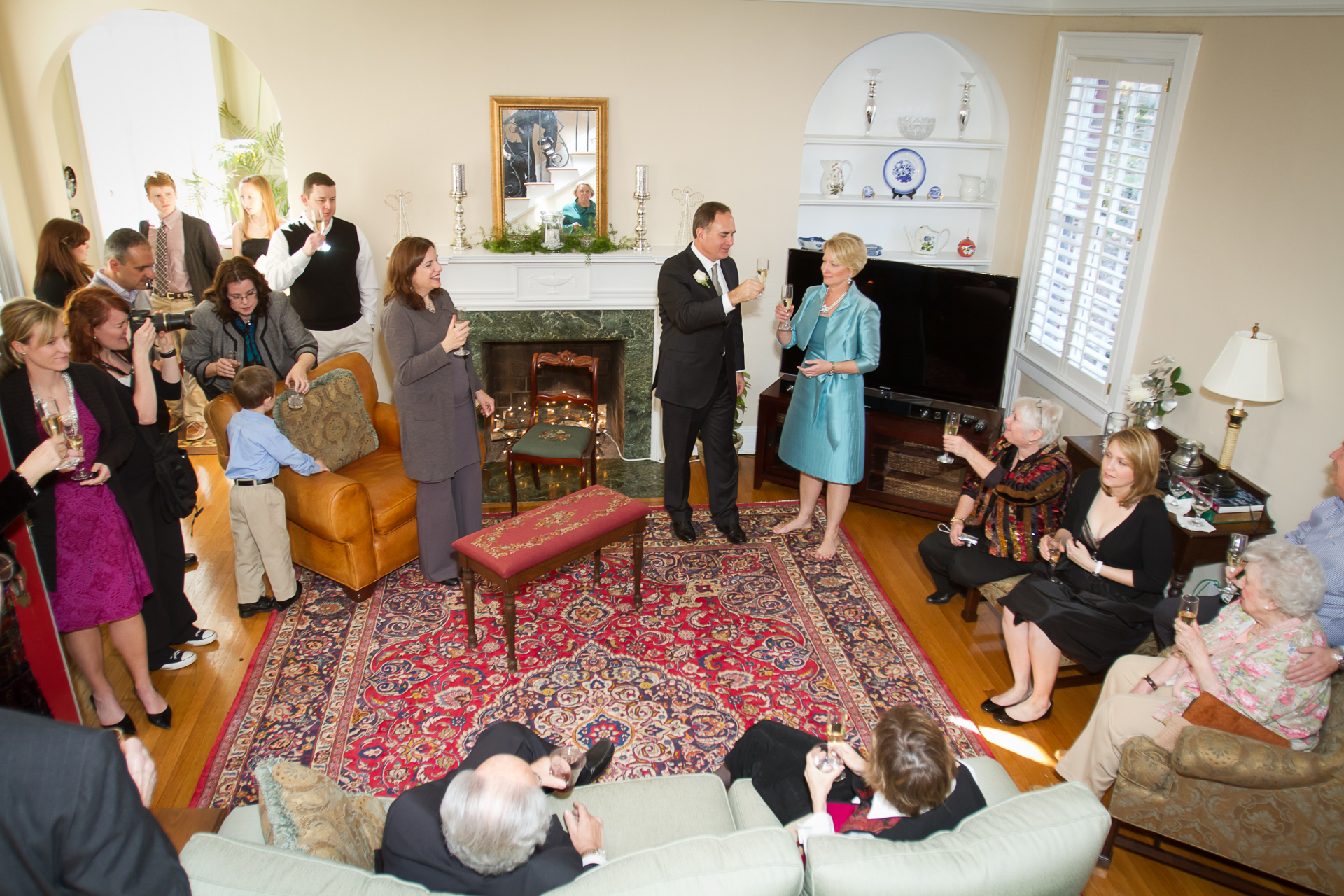 Atlanta GA Home Wedding Reception Photography | Family and friends surround the couple in their living room