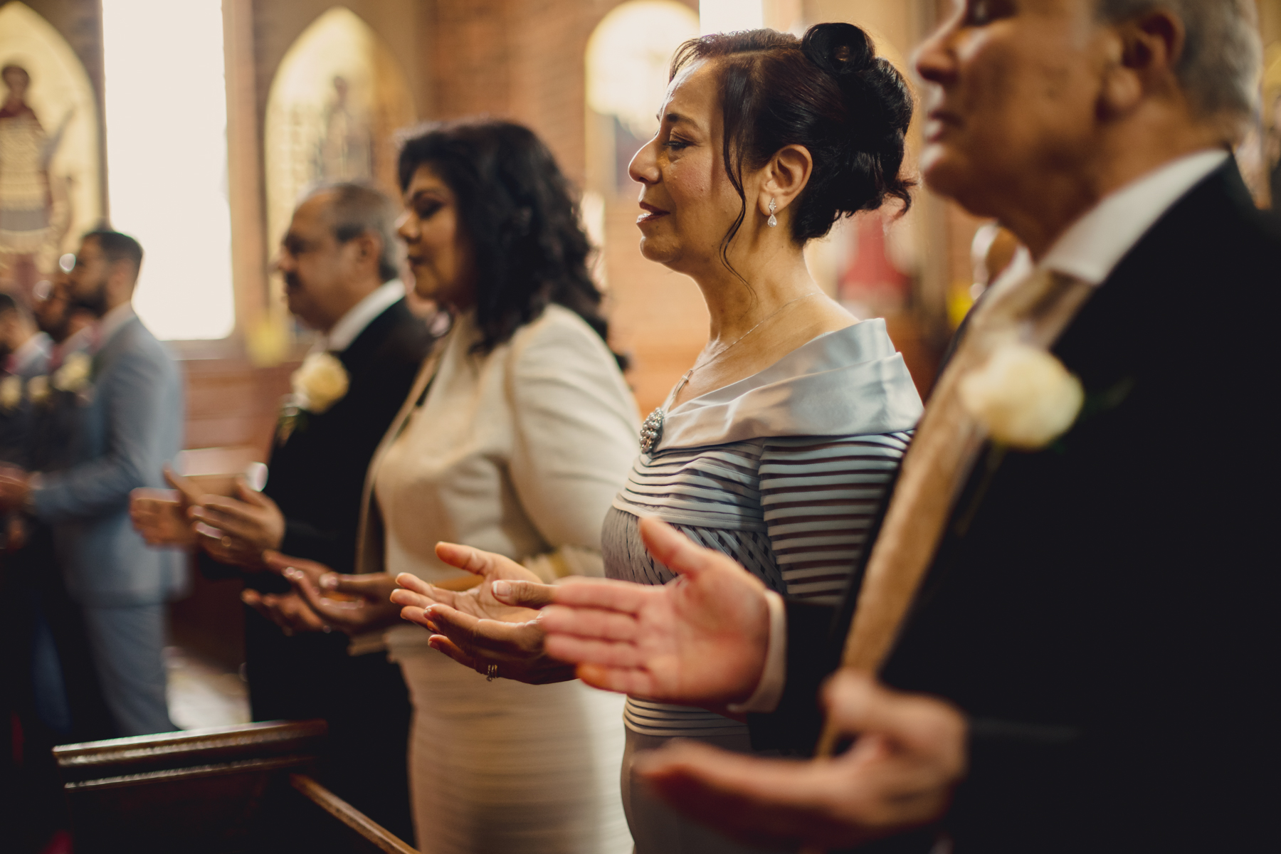 London Church Ceremony Wedding Picture - England | the family members and guests worship together