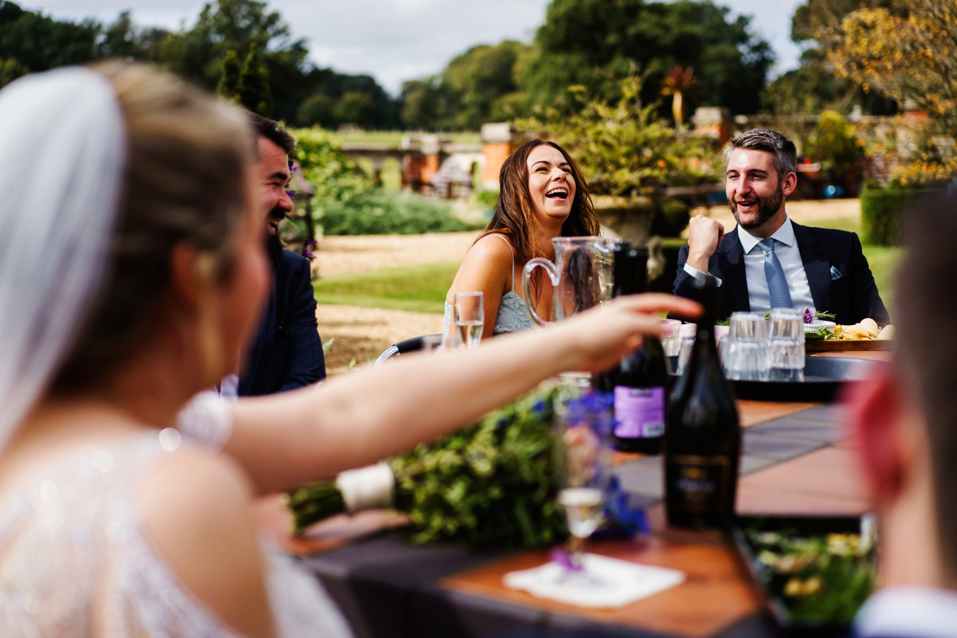 North Norfolk Wedding Photographer | The bride and groom enjoy a joyful al fresco wedding breakfast