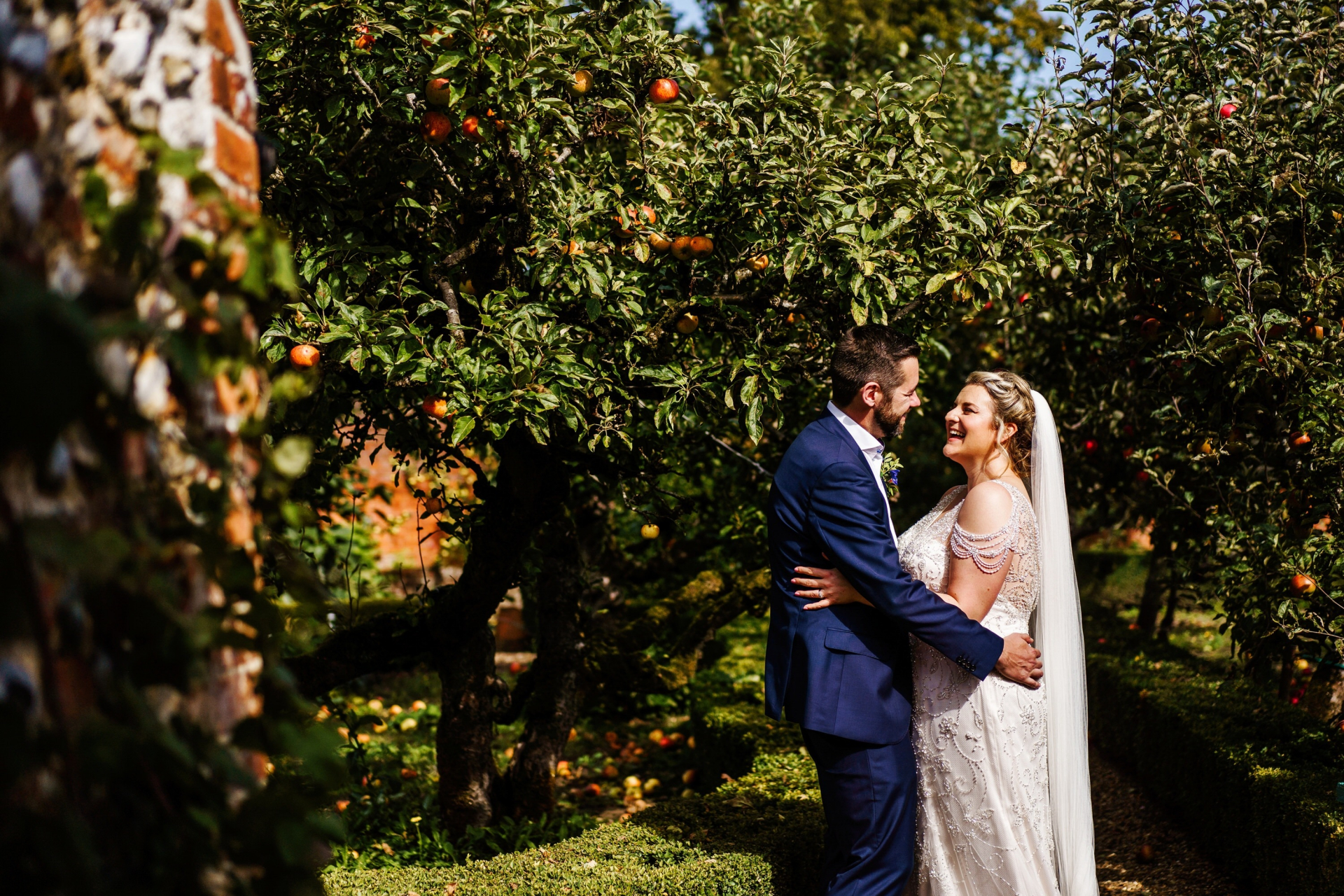Gunthorpe Hall Wedding Photos | The bride and groom stand together smiling and laughing