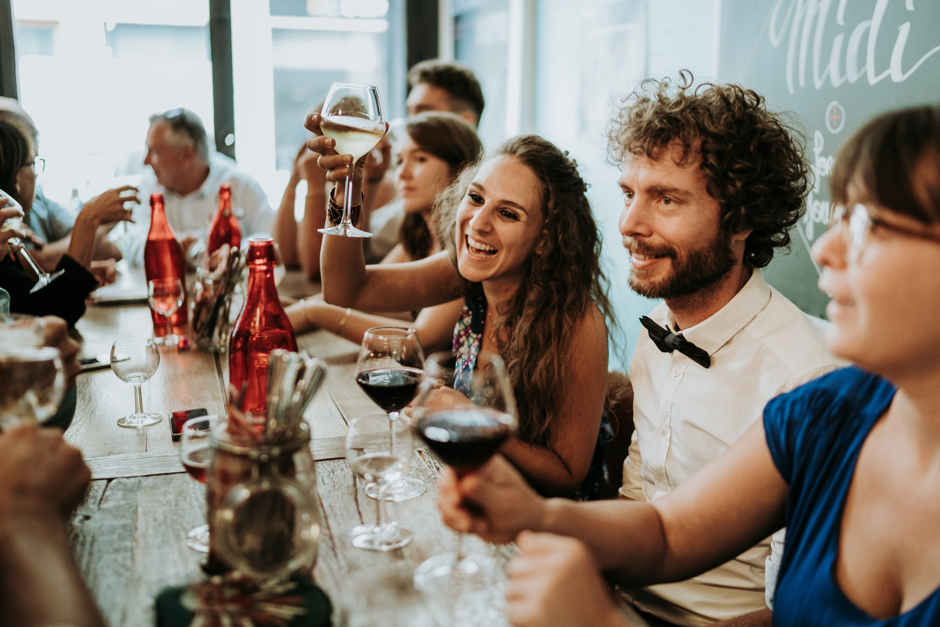 Documentary Wedding Photography in France | After the ceremony, the bride, groom, and their guests enjoy lunch together