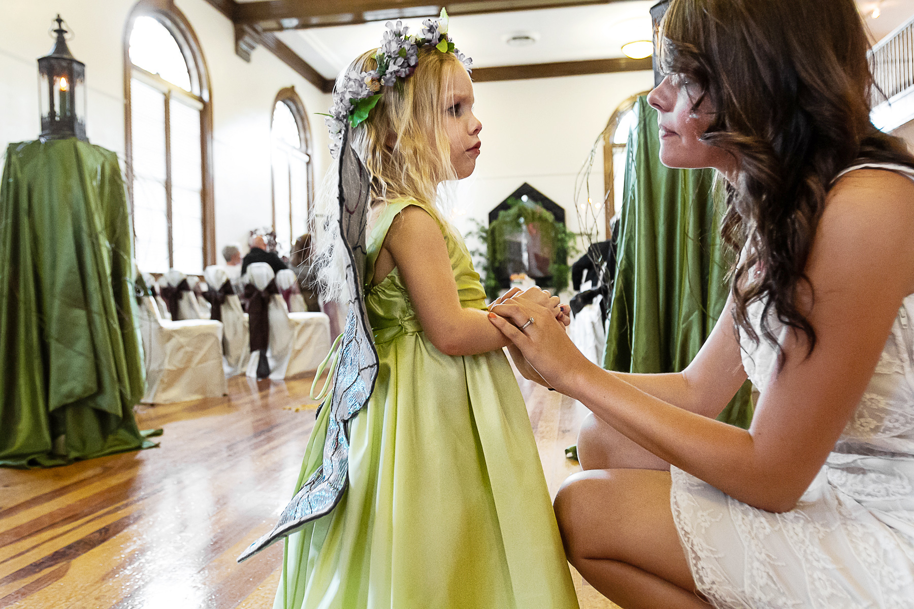 Wedding Photographers for Hattiesburg, MS | One of the flower girls, dressed in light green with a crown of flowers and fairy wings