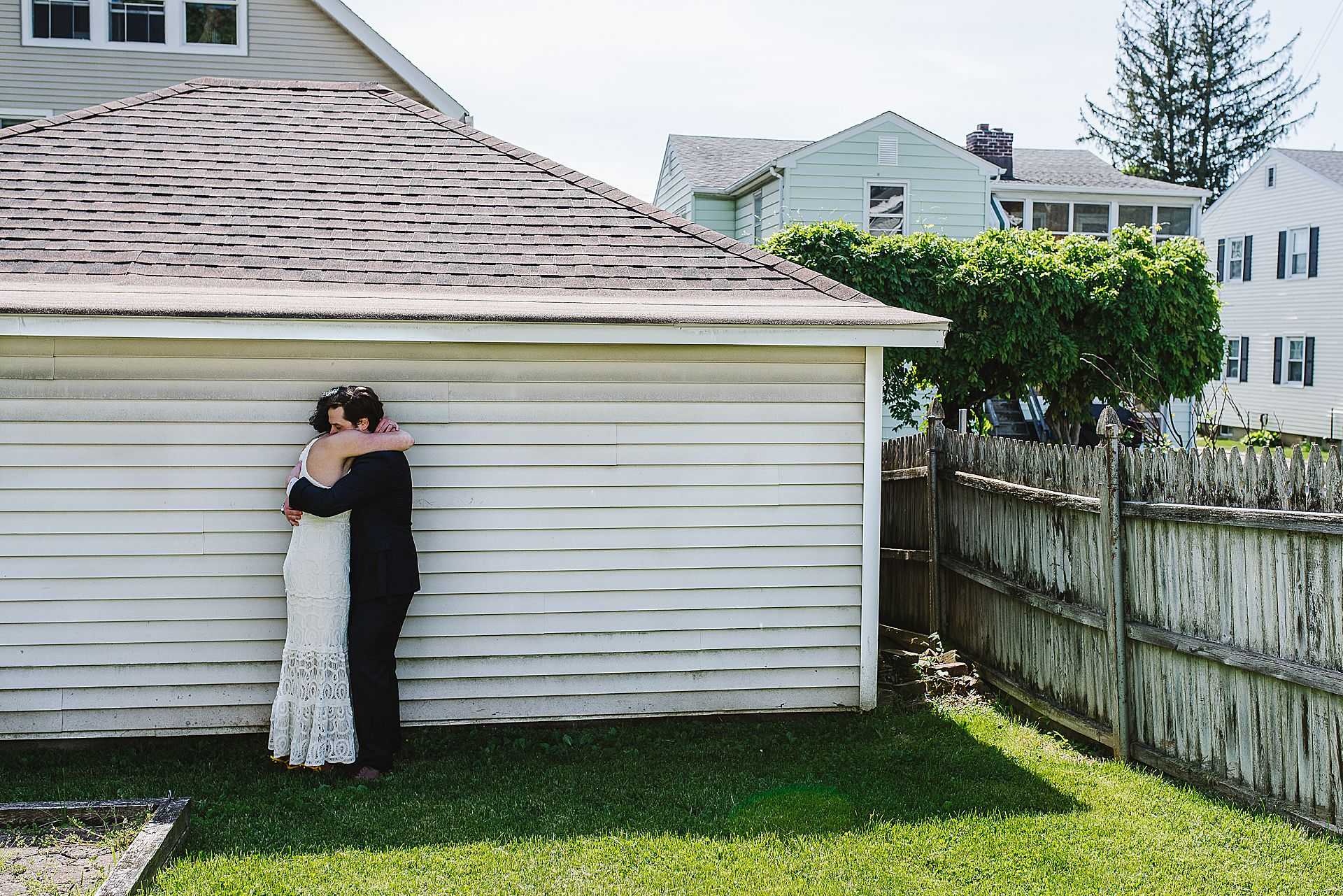Norwalk CT Wedding Photographer | The groom takes the bride into his arms after seeing her for the first time in her wedding dress