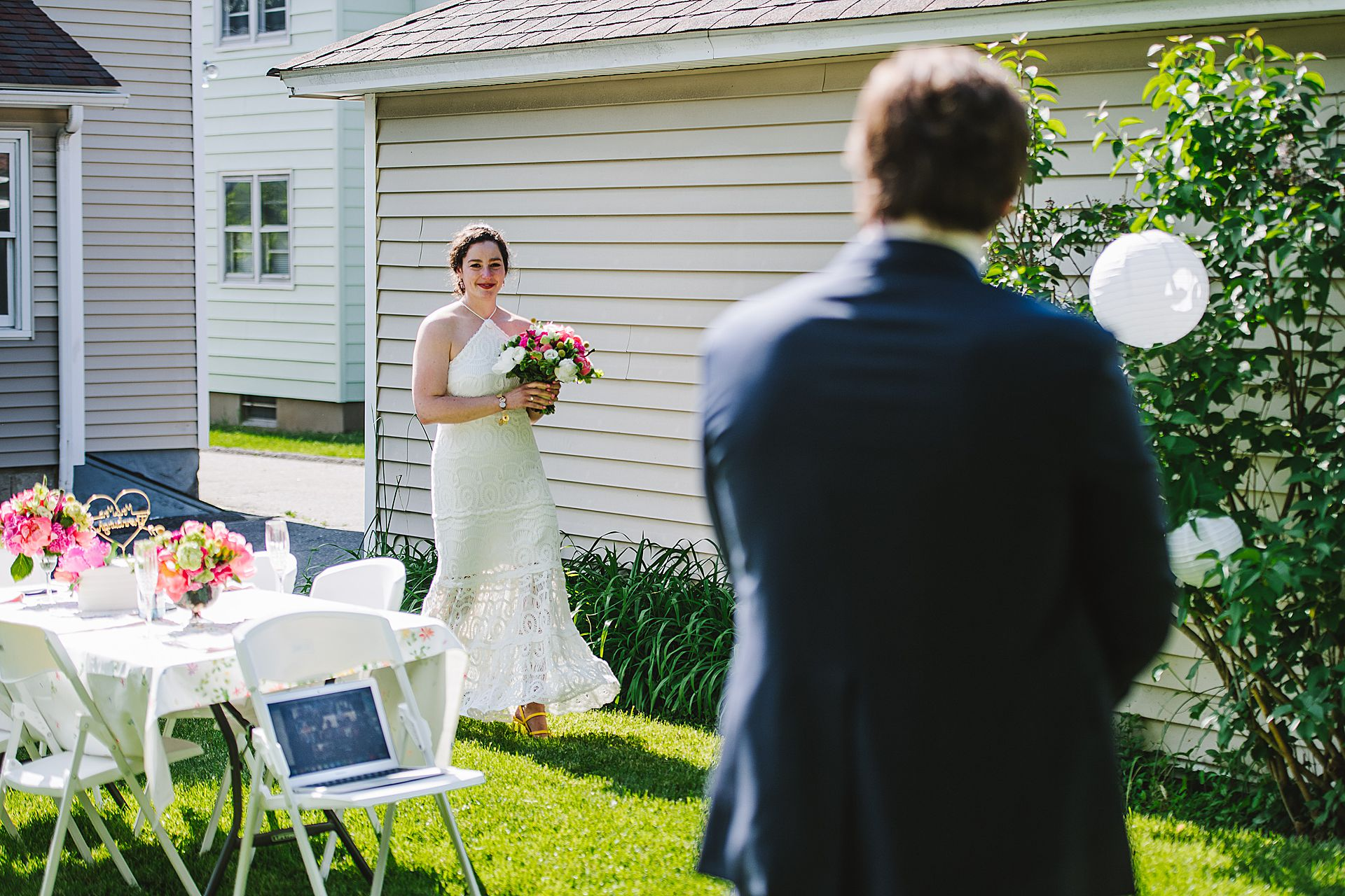 Backyard Wedding Photo in Norwalk, CT | The bride is Carrying a bright bouquet of flowers