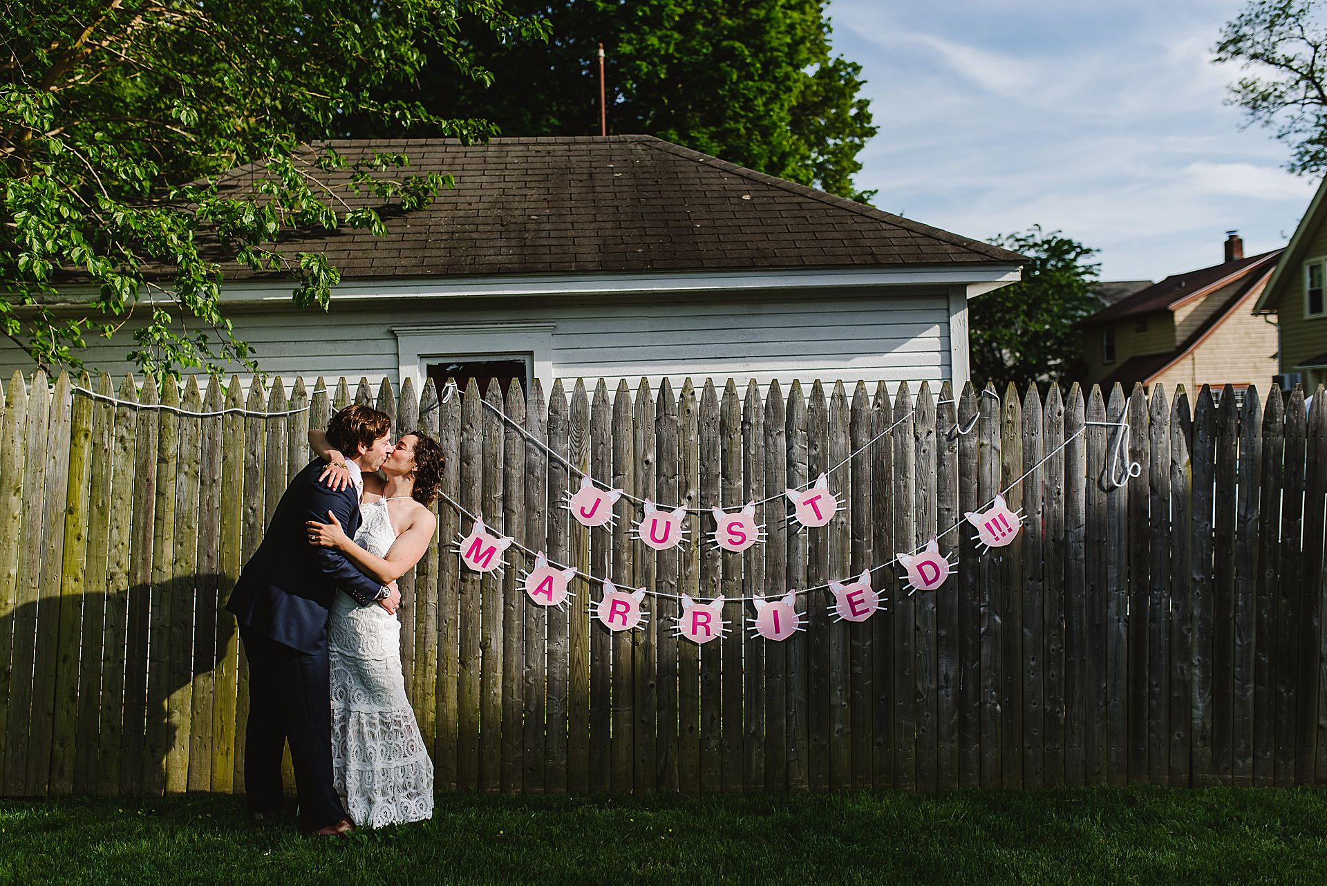CT Wedding Couple Portraits | The bride and groom share a playful kiss