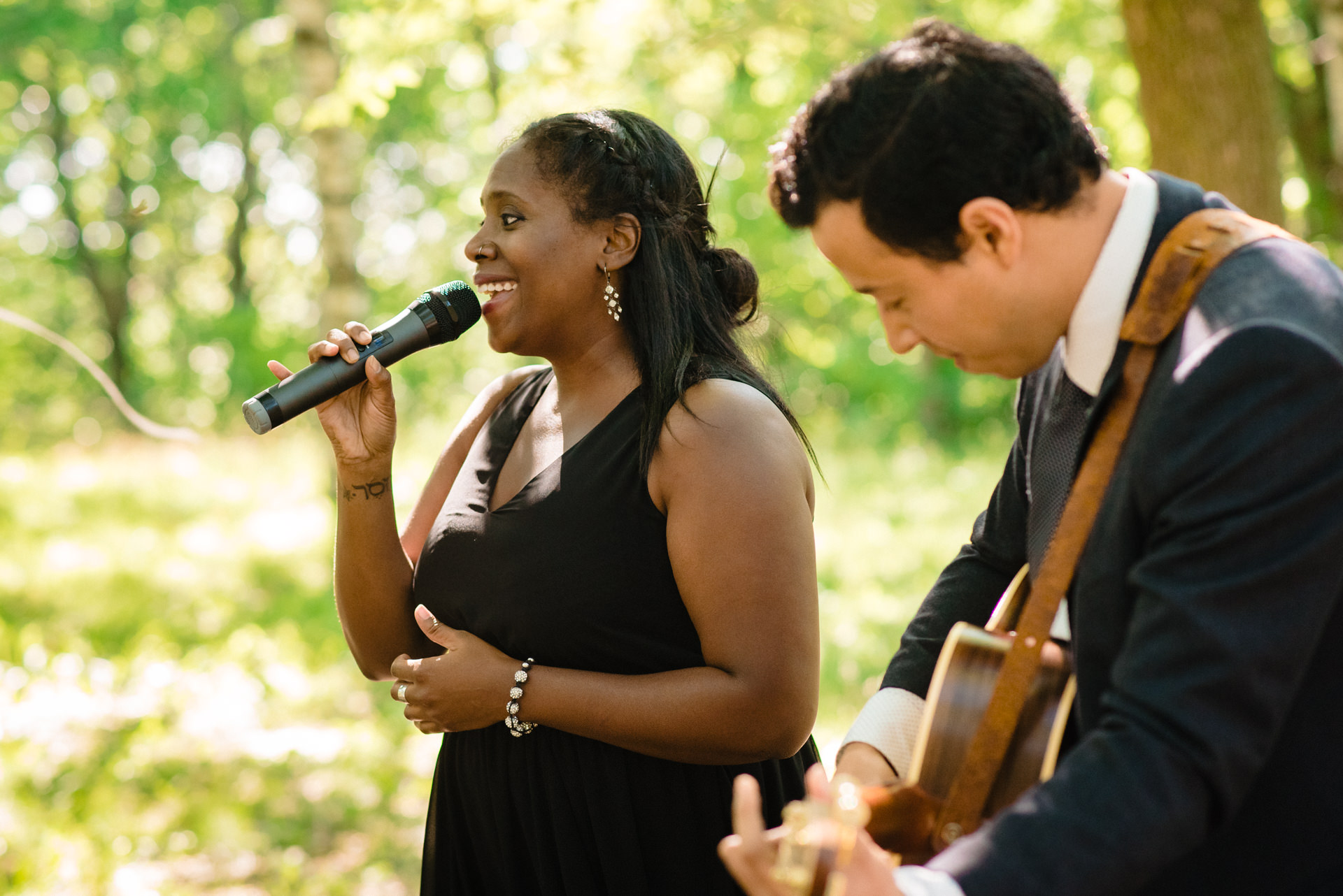 Mount Royal Park, Montreal, Quebec Wedding Photo | The brides neighbor and friend singing during the document signing