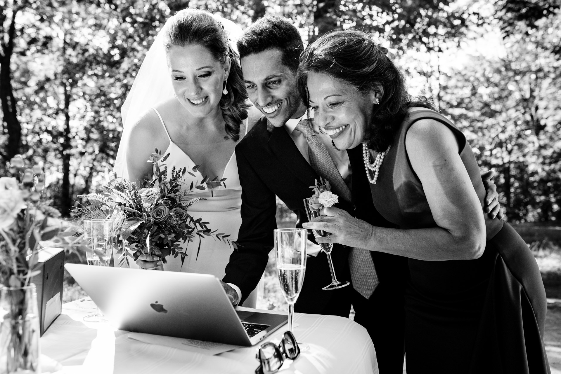 Montreal, Quebec, Canada Outdoor Wedding Photographers | The bride, groom, and his mother, chatting by video