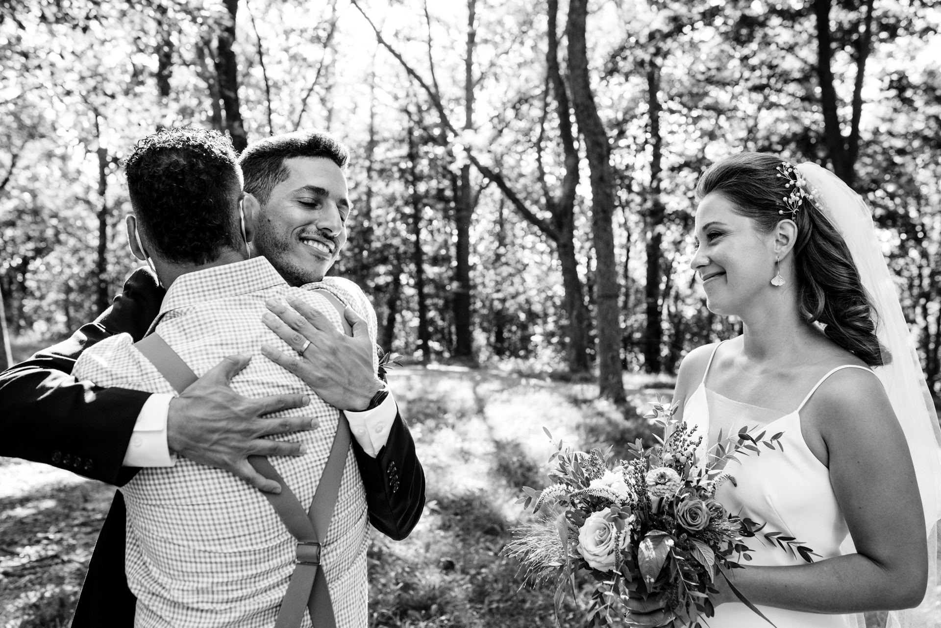 Montreal, Quebec Outdoor Wedding Pics | The groom receiving a masked hug