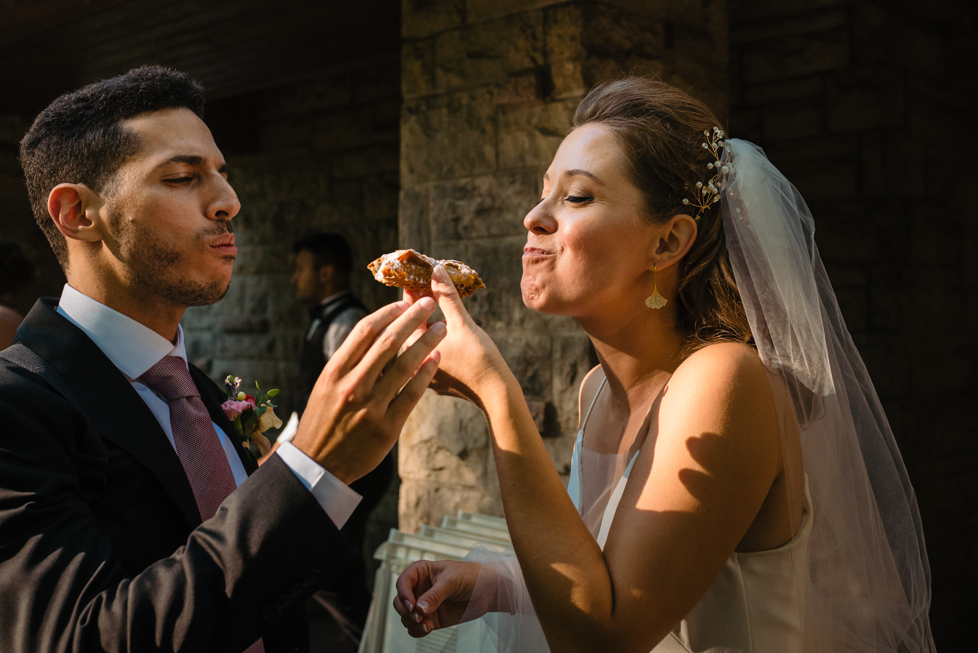 Montreal, Quebec Couple Wedding Image | The wedding couple sharing a cannoli together
