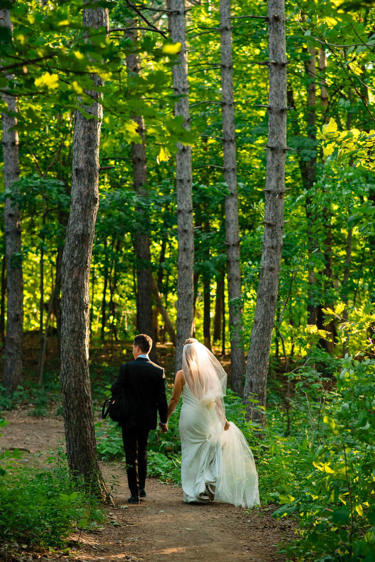Montreal, Quebec Couple Wedding Photography | The wedding couple walking down the mountainside