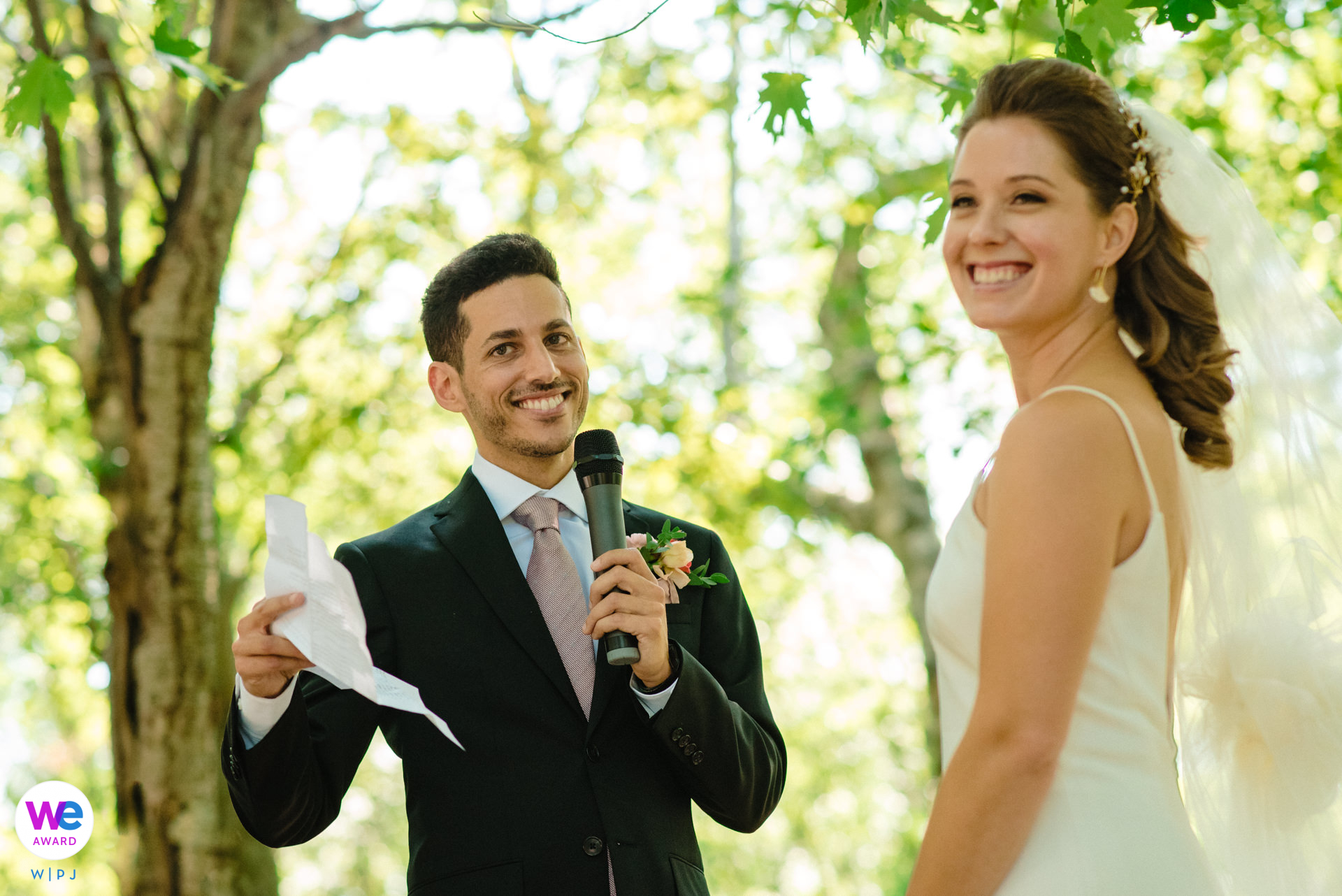 Wedding Ceremony Picture at Mont Royal Park | The bride and groom laugh with their guests