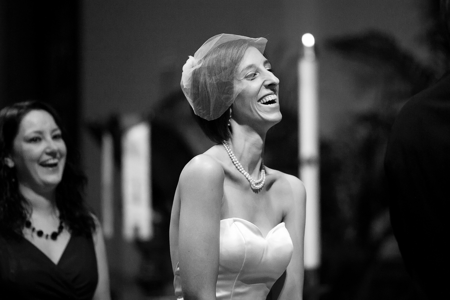 Grace UMC Church Wedding Pics - 458 Ponce de Leon Ave | The bride laughing during the ceremony