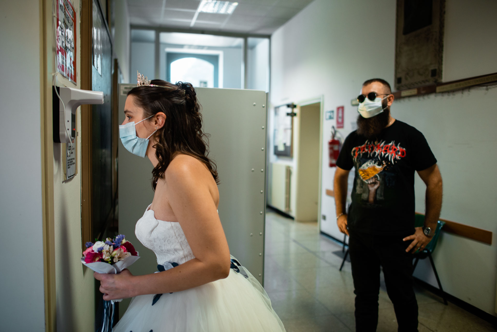 Castegnato City Hall, BS Wedding Photographers | The bride leans in for a temperature screening while wearing a face mask