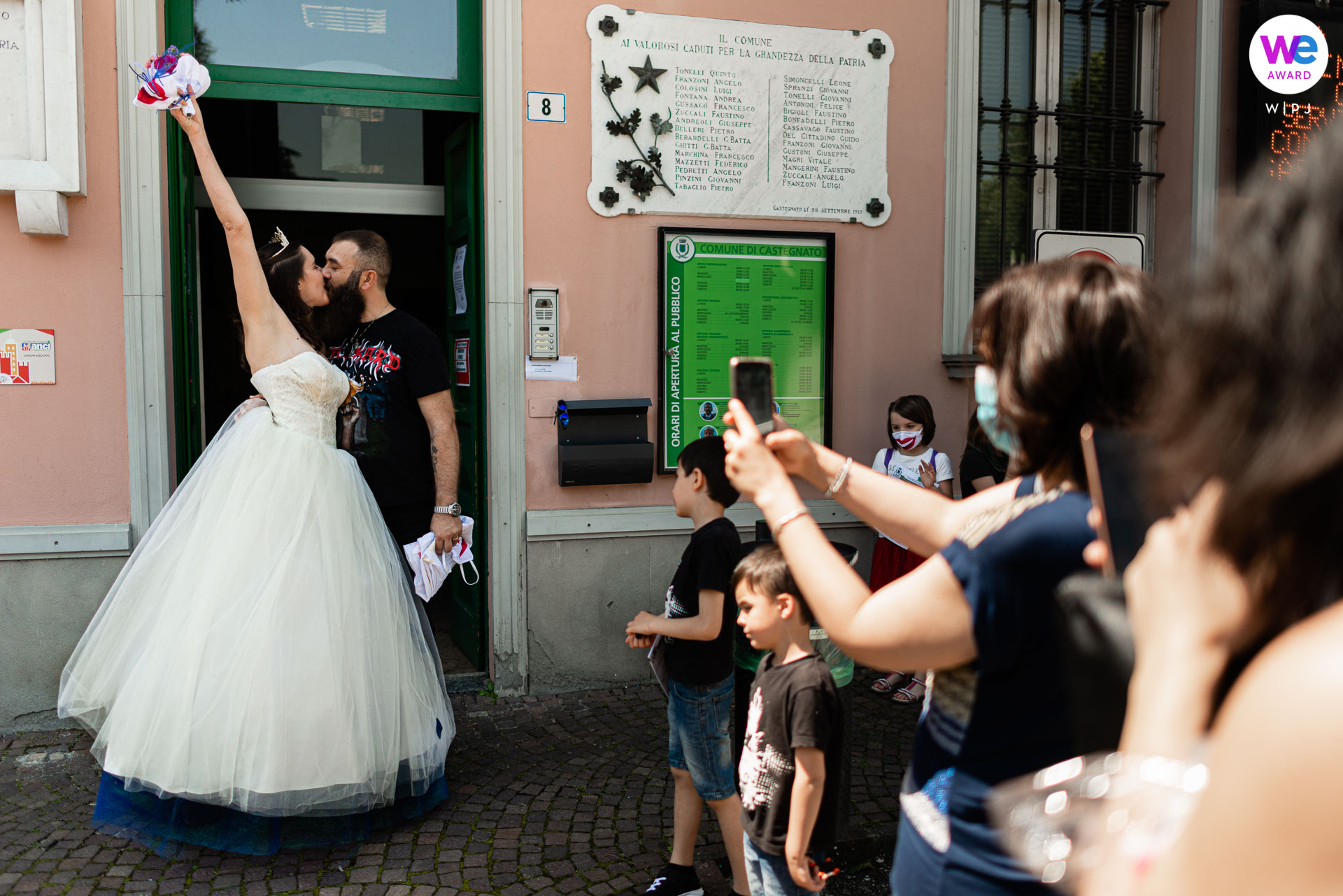 Wedding Photography in Brescia, Italy | The bride and groom seal their new marriage with a celebratory kiss after leaving the Castegnato City Hall