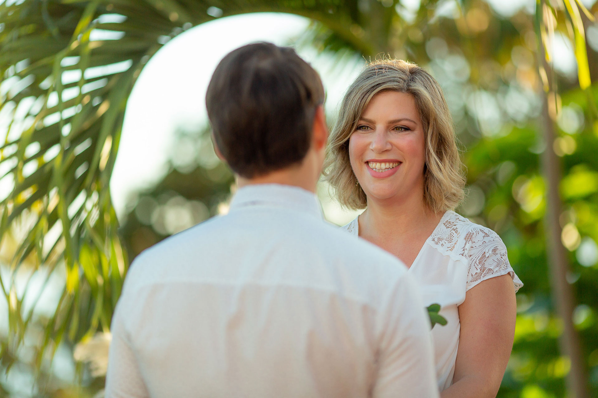 Costa Rica Destination Wedding Photographers | The bride smiles with joy during the wedding ceremony