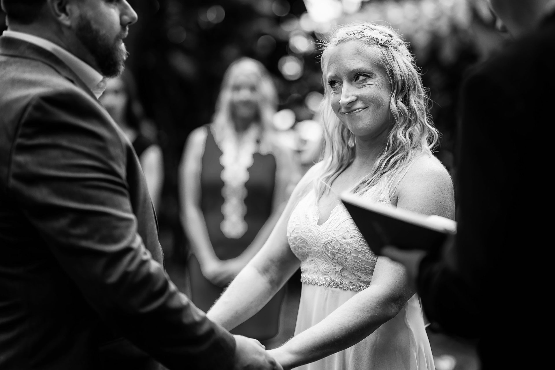 BW Costa Rica Outdoor Elopement Ceremony Picture | The bride gives the groom a look