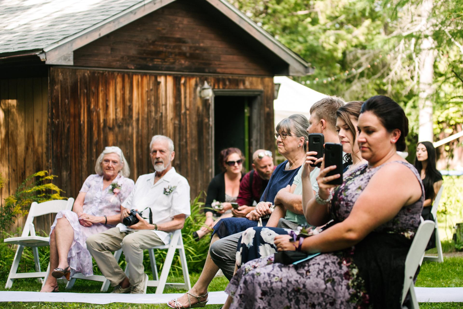 Kanata, Ottawa, Outdoor Ceremony Wedding Image | The guests witness the backyard ceremony