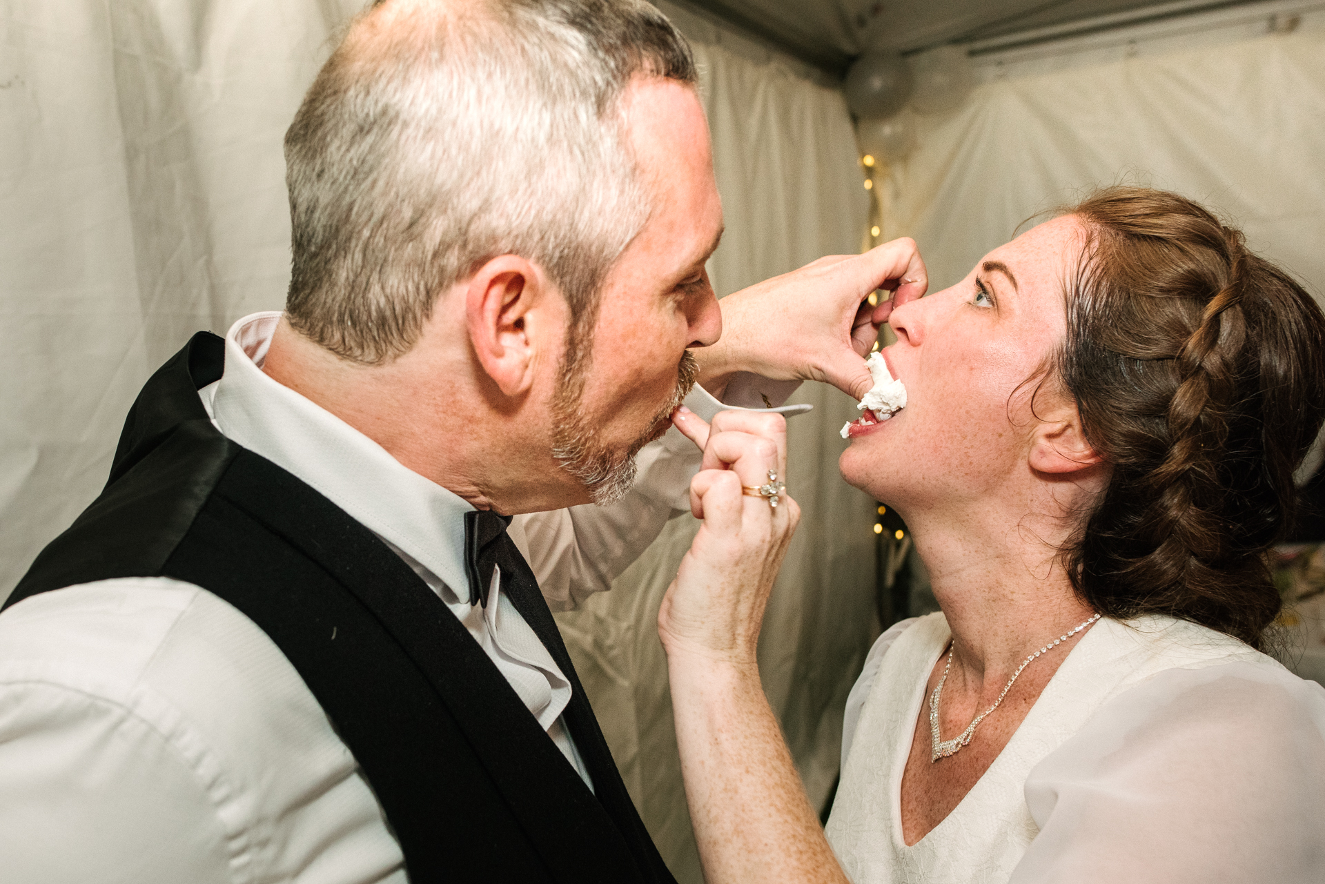 Ottawa, Backyard Wedding Image from Kanata | it's time for a slice of cake... Or a thumb-full