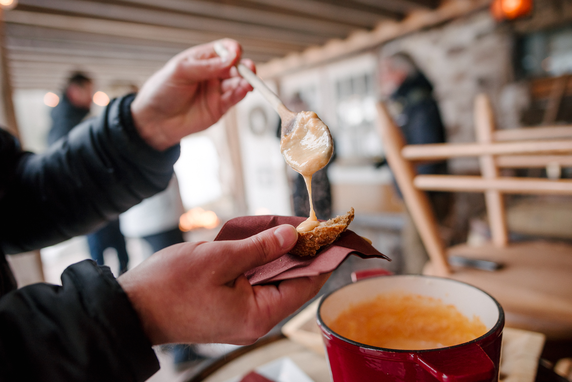 Ontario Wedding Detail Pic from Rockport Barn | One of the couple's sons takes a sampling of the fondue