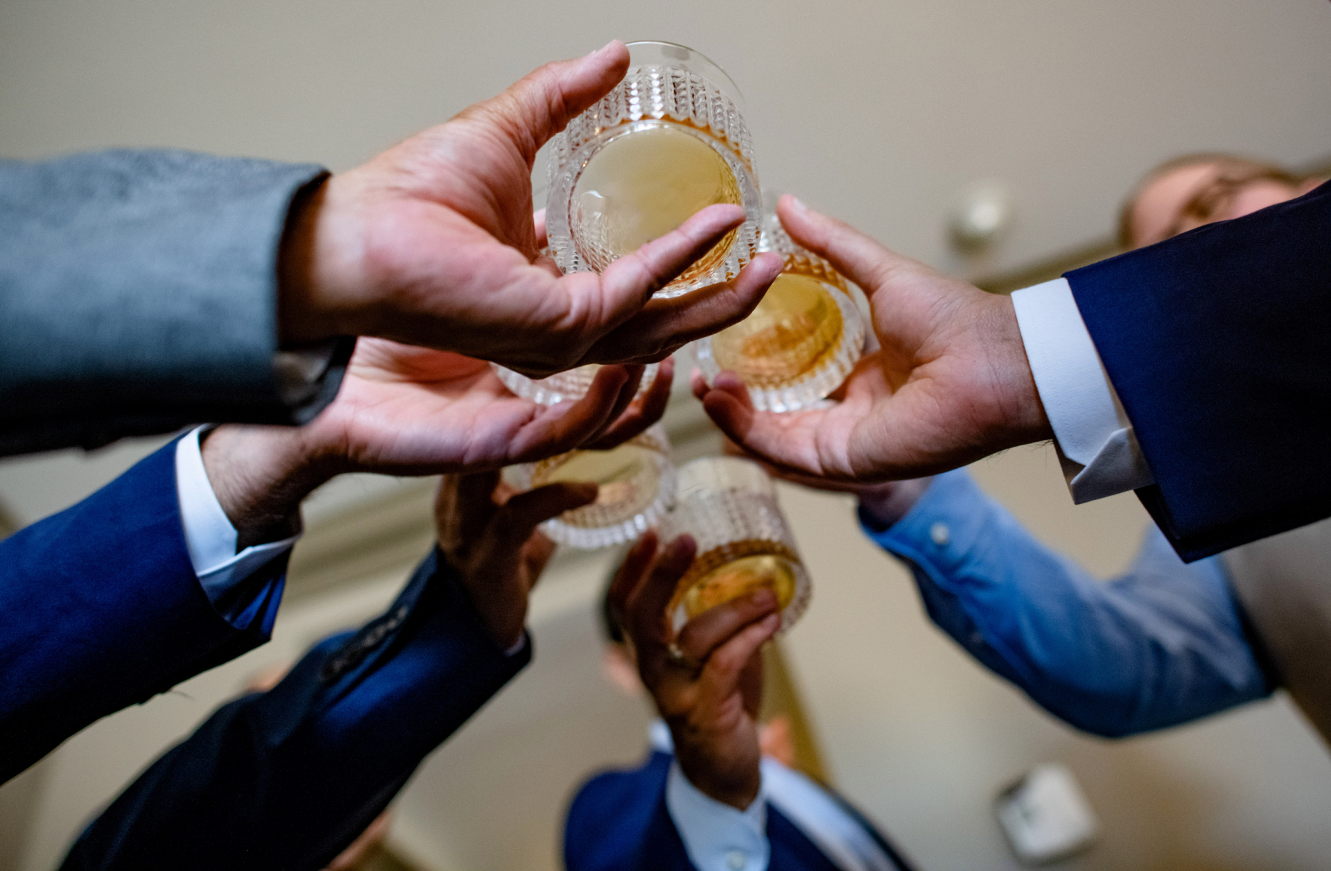 Real Wedding Image from a Scottsdale Wedding Venue | The groom's friends toast him and his new bride