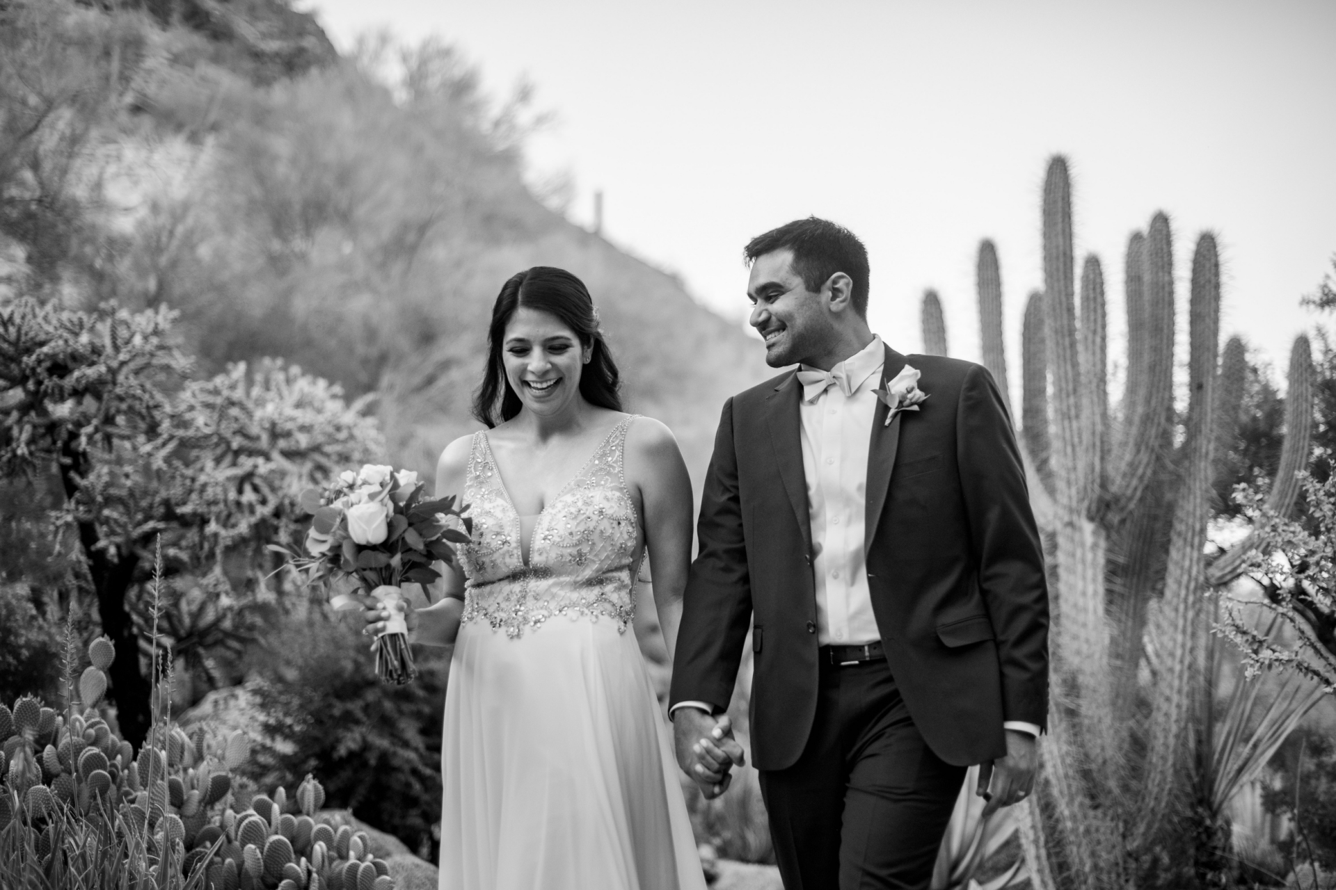 Outdoor Wedding Venue Portrait in Scottsdale, Arizona | The groom looks at his bride with pride and love