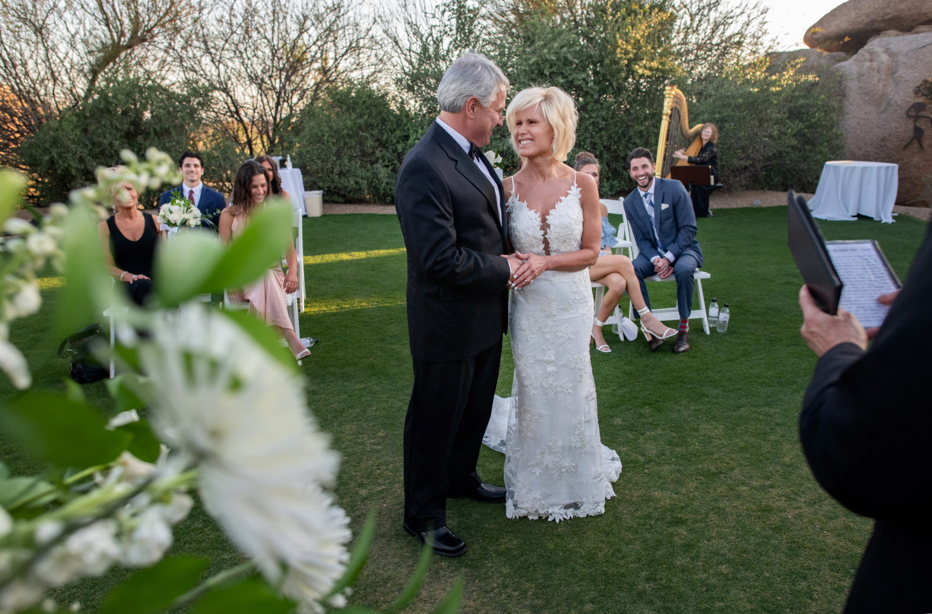 Arizona Wedding Picture - Boulders Resort & Spa Scottsdale | a harpist set the stage with gentle, cascading music