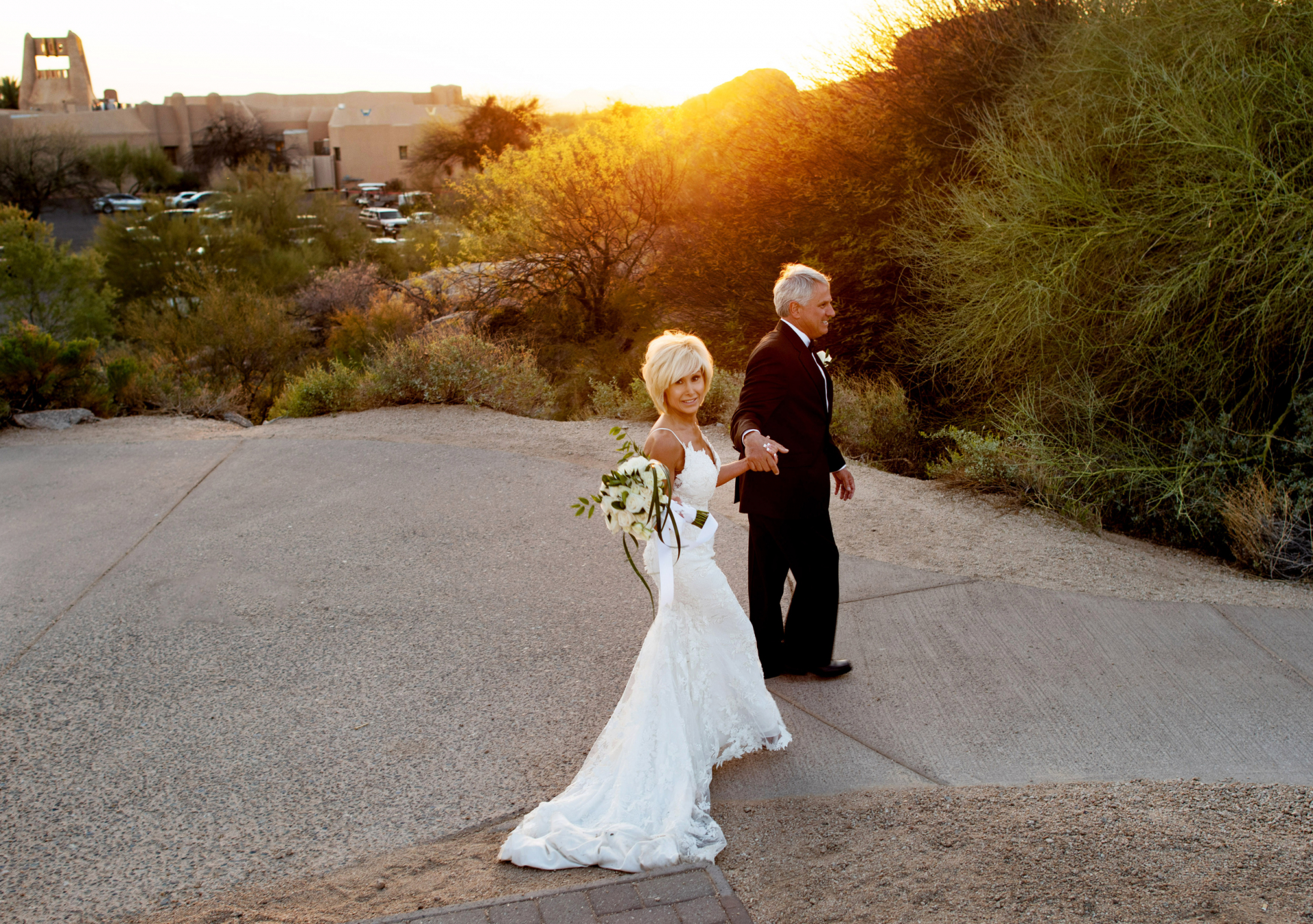 Boulders Resort Scottsdale Wedding Photographer | the sun sets behind them