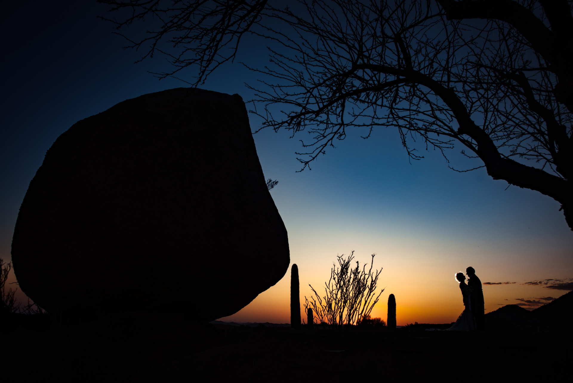 Scottsdale AZ Wedding Couple Portrait | Bride and groom are silhouetted in the background