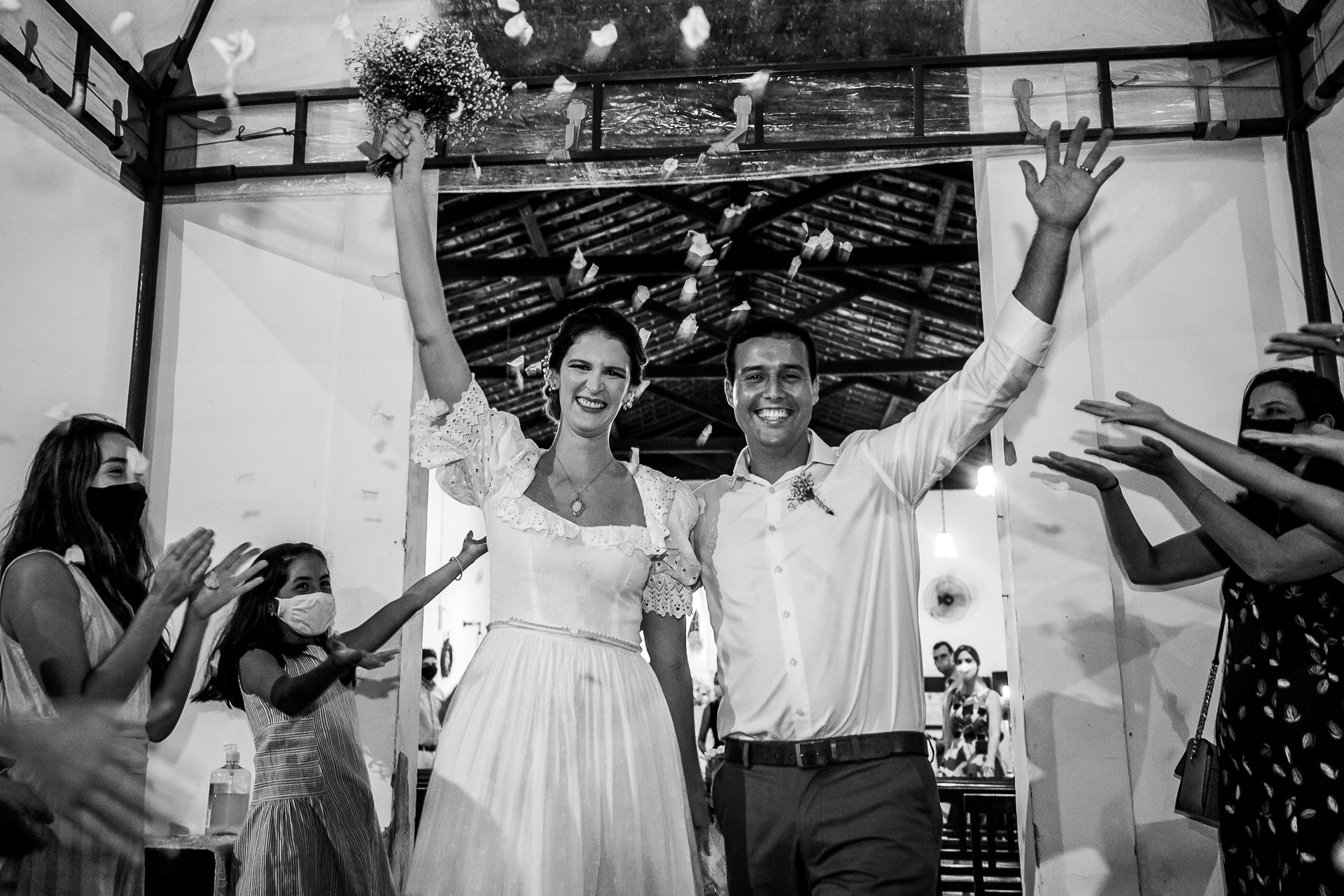 Wedding Ceremony Celebrations Image - AL, Brazil | guests toss flower petals in the air to celebrate